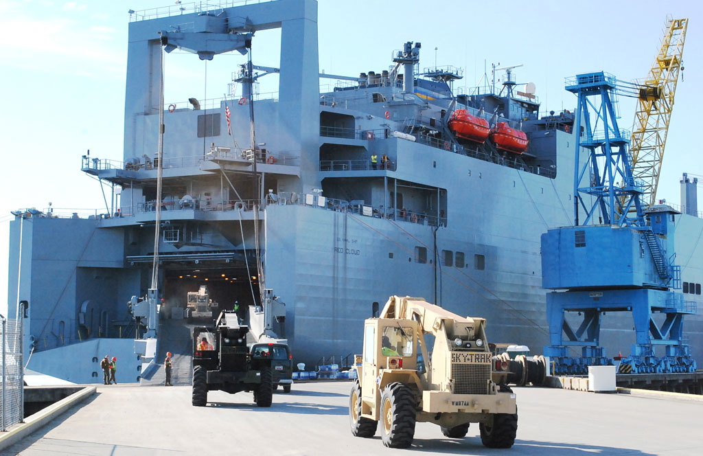 Vehicles drive aboard the USNS Red Cloud at Wharf Alpha, Joint Base Charleston, SC
