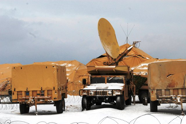 A Humvee is deployed with its communications satellite dish