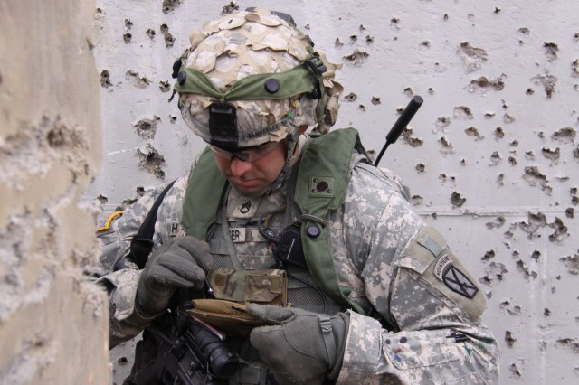 A Soldier using a Nett Warrior device to communicate