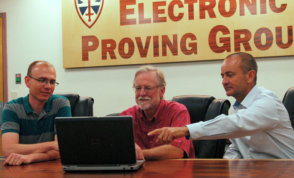 Deputy Director of SDSI at ASU, Mark A. Giddings, points out data to Pat Kerr