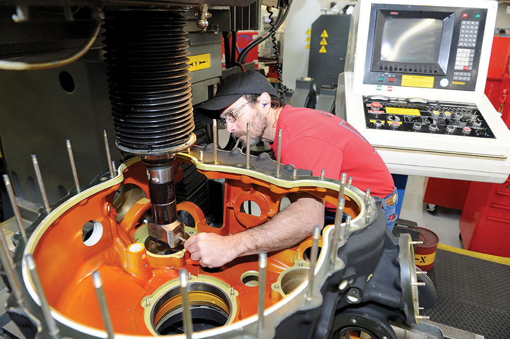 CCAD employee Frankie Thomas machines the main transmission housing for an AH-64 Apache.
