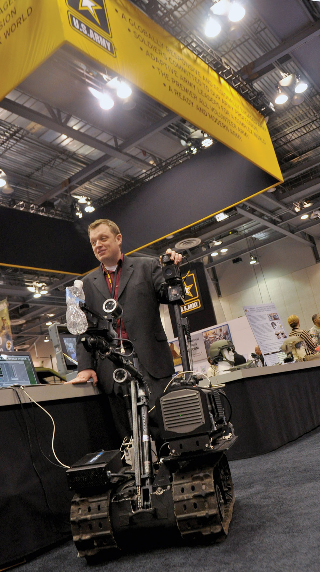 TARDEC engineer Dan Maslach demonstrates a Talon robot outfitted with 200-watt fuel cells at the AUSA ILW Winter Symposium and Exposition in February. The kinetic-bomb-detecting robot can operate in adverse conditions and rough terrain, and its improved fuel cells will lighten the load that the warfighter carries in the field. (U.S. Army photo by Cherish Washington, AMC)