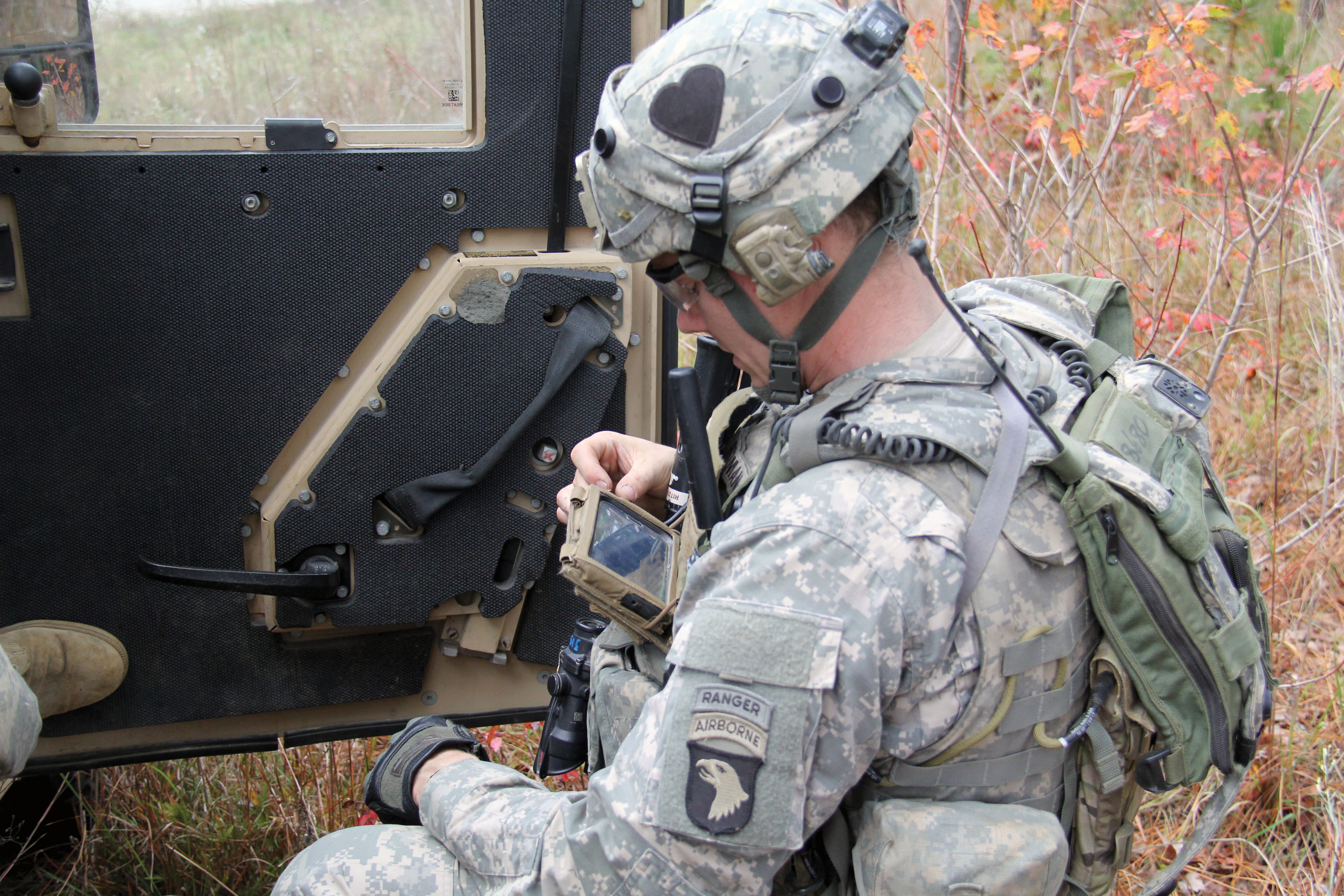 A Soldier from the 2nd BCT, 101st Airborne Division uses a Nett Warrior device to communicate at the JRTC in November 2013. STARNet and the NaN will use standardized maps, messaging and icons to provide a unified, familiar experience, from smartphones to vehicles to command posts. (Photo courtesy of JRTC Operations Group Public Affairs)