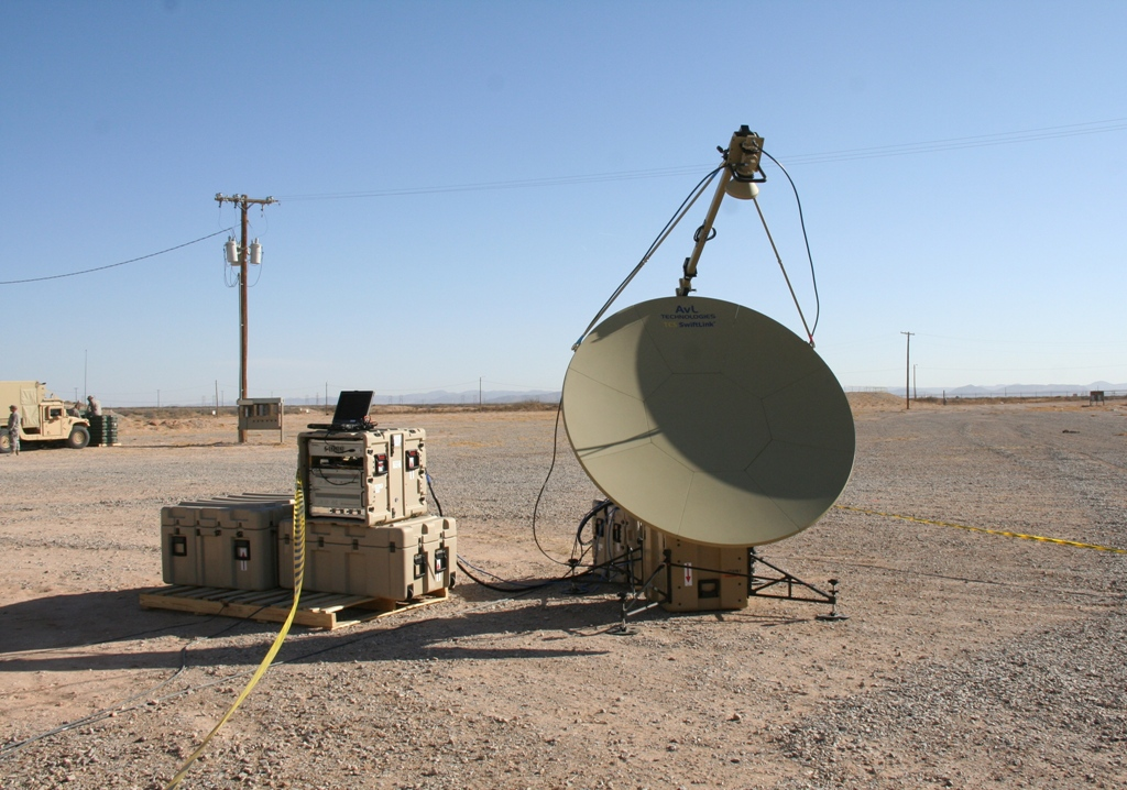 The Tropo Lite, a transit case-based tropospheric (tropo) scatter communications system, was assessed at Network Integration Evaluation 14.2 in May to replace the Army's current truck and trailer-based system. Tropo systems shoot microwaves instead of satellite radio frequencies, allowing for secure, high-speed transfer of large volumes of data between sites and over terrestrial obstructions such as mountains. Photo Credit: Amy Walker, PEO C3T