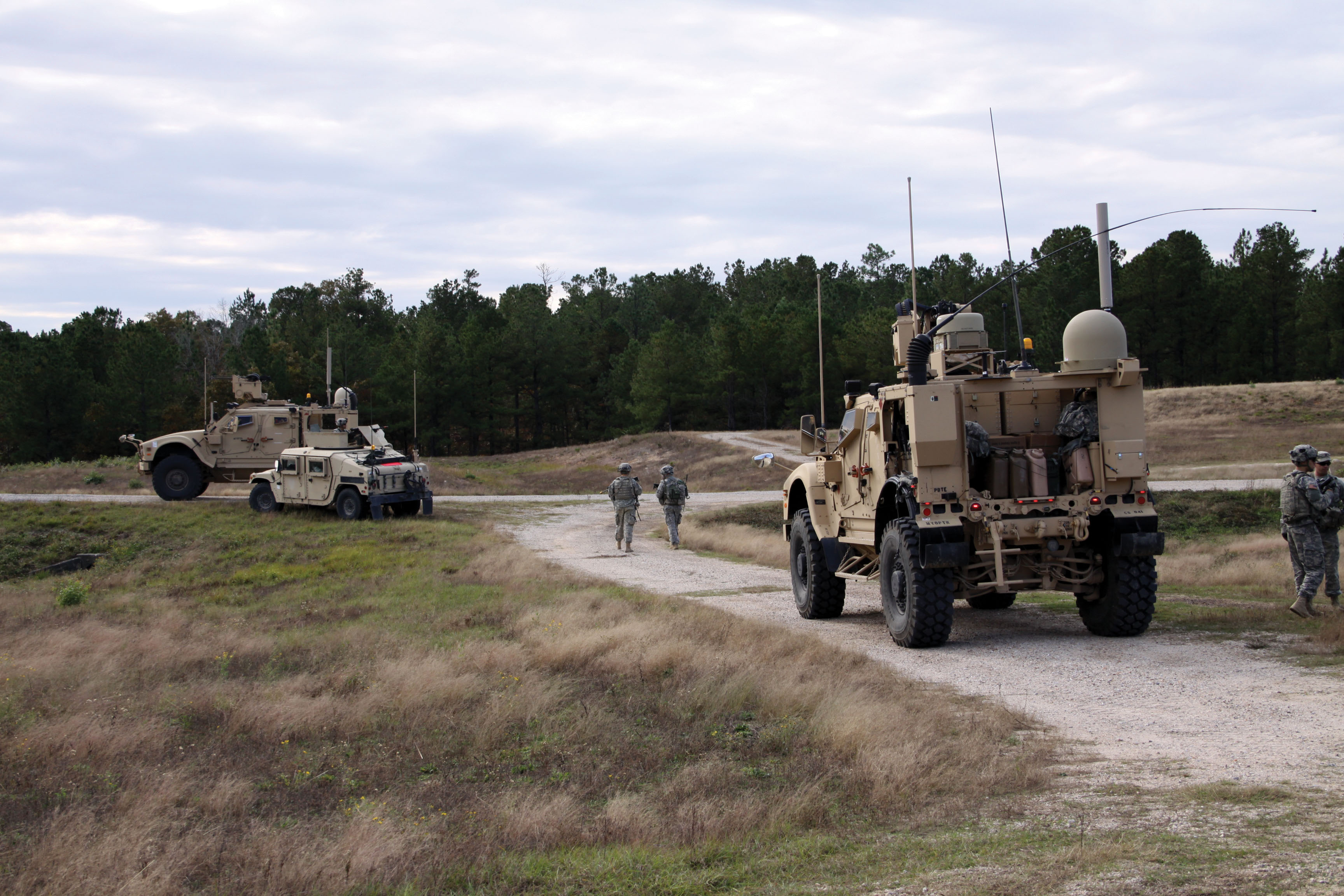 Soldiers with the 2nd BCT, 101st Airborne Division (Air Assault) train at the Joint Readiness Training Center (JRTC), Fort Polk, Louisanna, in November 2013 using vehicles, left and right, equipped with Warfighter Information Network - Tactical (WIN-T) Increment 2. Some WIN-T Network Operations tools enable communication officers to identify how well systems such as these are actually working on the battlefield, so as units move out in any direction, they can more easily manage the network and keep links connected. (Photo courtesy of JRTC Operations Group Public Affairs)