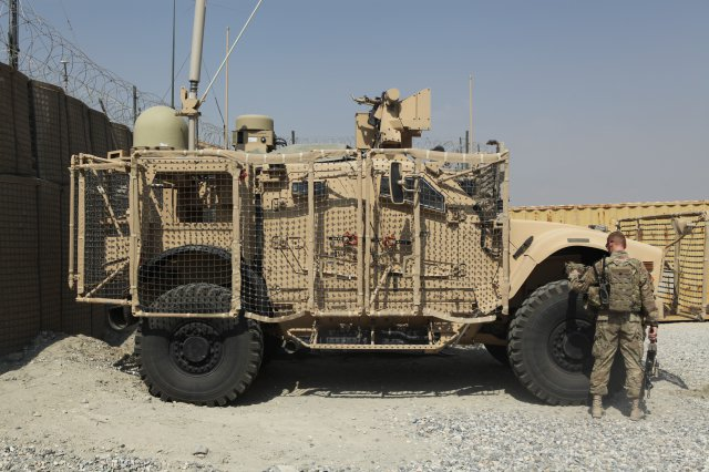 A Solider checks a Warfighter Information Network-Tactical (WIN-T) Increment 2 Point of Presence (PoP)-equipped vehicle at Forward Operating Base Gamberi, Afghanistan in September 2013. As the SNE evolves, leaders say they are leveraging the PoP as the Army originally intended: to conduct mission command away from their command posts. (Photo Credit: SPC Edward Bates, courtesy of 4th Brigade Combat Team, 10th Mountain Division Public Affairs)
