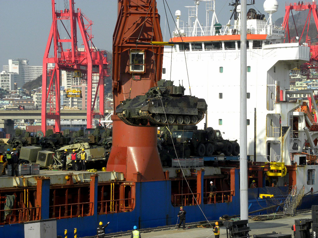M2A3 and M3A3 Bradley Fighting Vehicles discharged from the Ocean Titan are staged at the Port of Busan