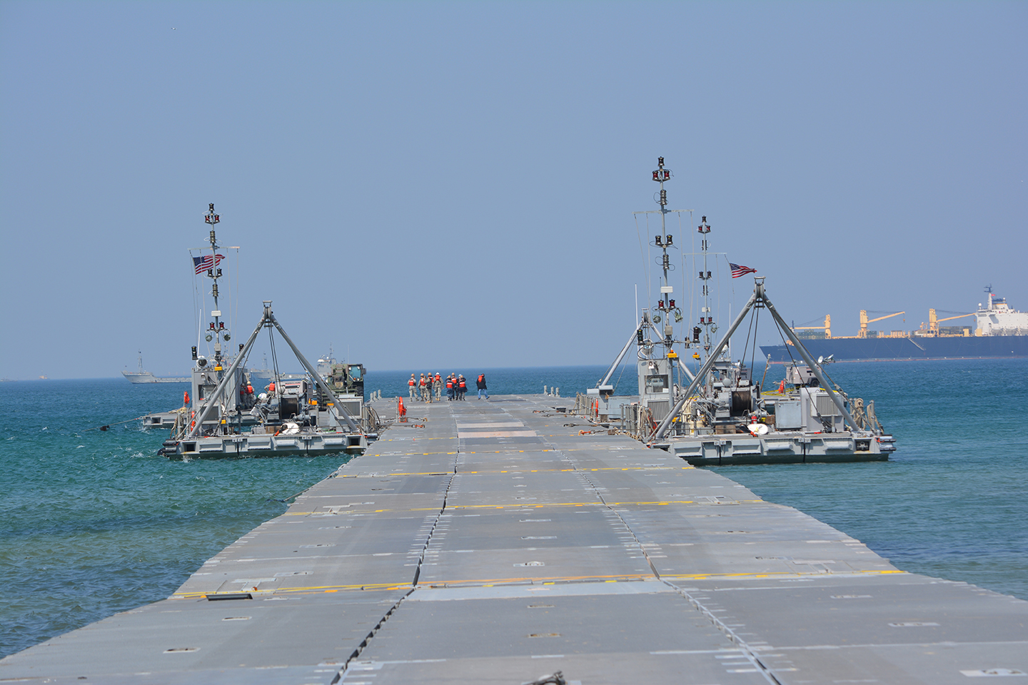 Soldiers of the 331st Transportation Company position a floating causeway with two warping tugs as part of the Combined/Joint Logistics Over the Shore (CJLOTS) 13 exercise in Pohang, South Korea. (Photos by CW4 Rick Deans, Army Field Support Battalion-Northeast Asia)