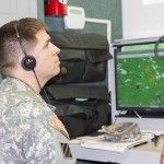 Maj. John Culpepper, simulations operations officer, 3rd Combat Aviation Brigade, watches the action during a field exercise using the LVC-IA at Hunter Army Airfield, Georgia. (Photo by Sgt. William Begley, 3rd CAB Public Affairs)