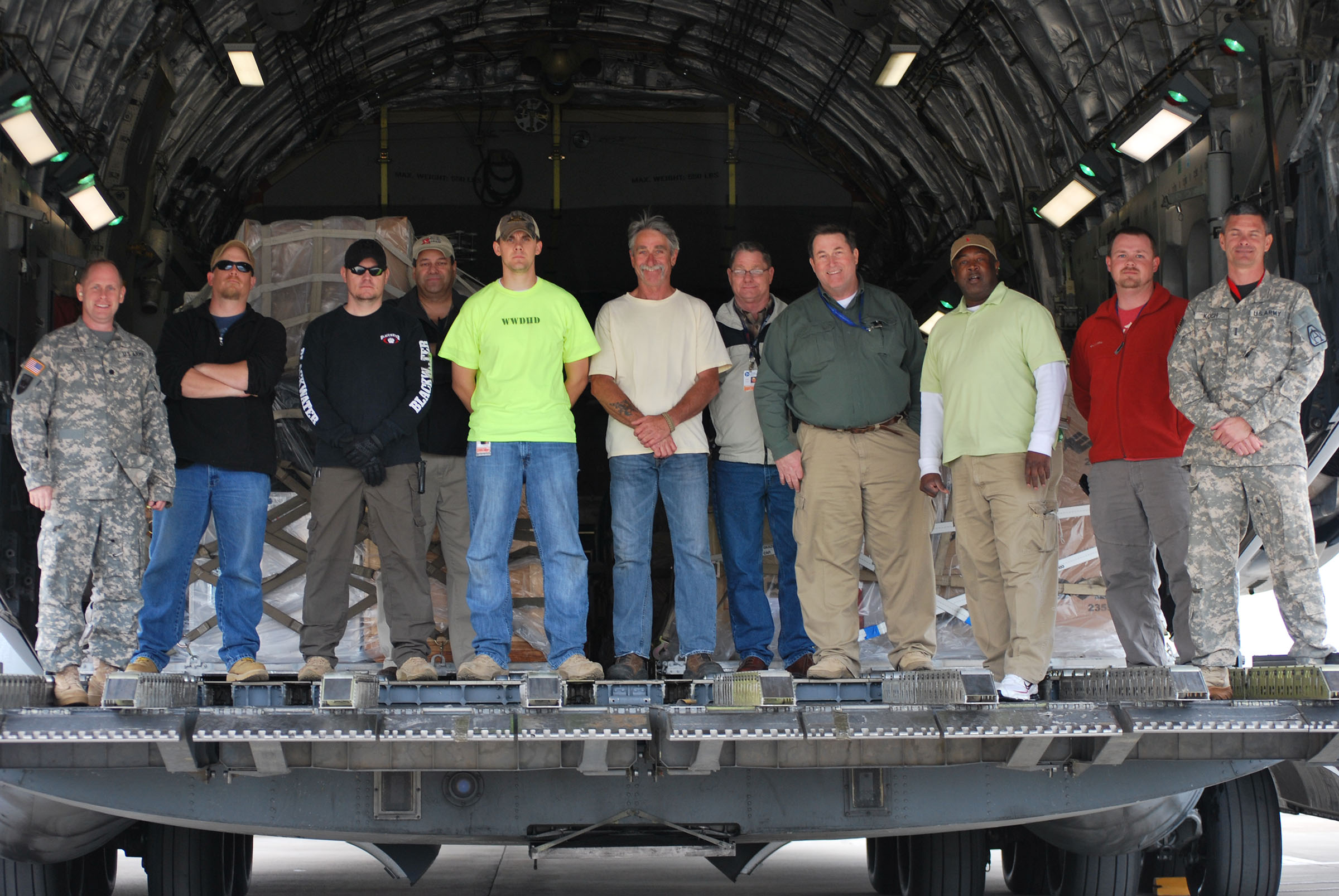 Lt. Col. James Mills (far left) and his team pose for a photo inside a C-17, just before taking off to deliver three IA-407 helicopters to Iraq in April 2013
