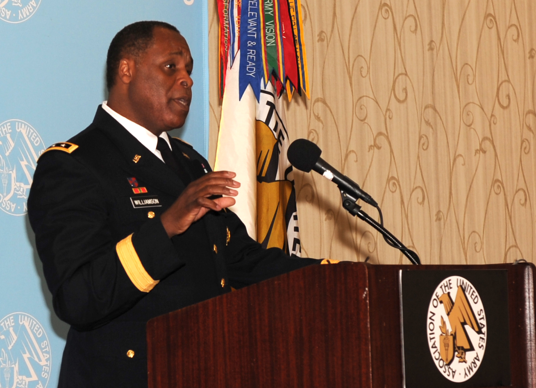 Lt. Gen. Michael E. Williamson, the principal military deputy to the assistant secretary of the Army for Acquisition, Logistics and Technology, talks about America's industrial base at the Association of the U.S. Army's monthly breakfast, in Arlington, Va., July 24, 2014. (Photo by J.D. Leipold)