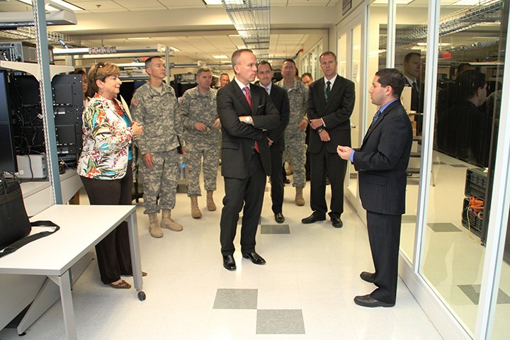 Scott Newman, program director for Systems Engineering and Integration, CERDEC Space and Terrestrial Communications Directorate, shows Under Secretary of the Army Brad R. Carson the C4ISR Systems Integration Laboratory, the site for lab-based risk reduction for systems prior to Network Integration Evaluations at Aberdeen Proving Ground, Md. on July 29, 2014. (Photo Credit: Kyle Bond)