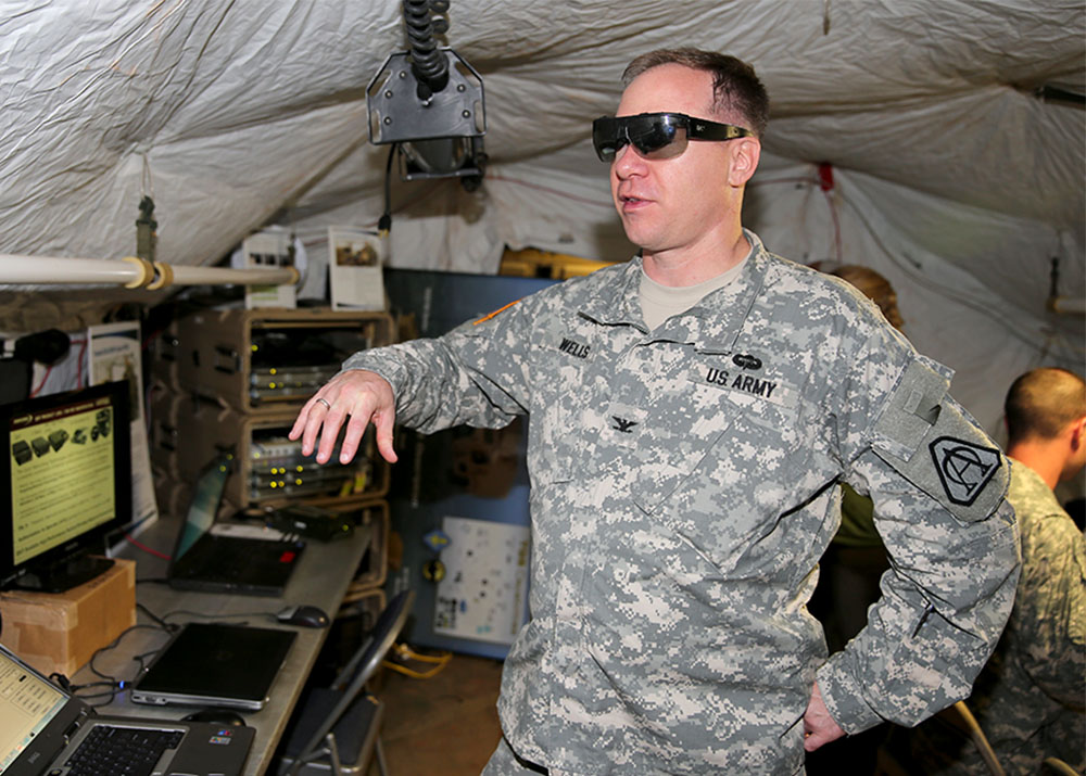 Col. Charles Wells assesses the tactical glasses being demonstrated at Enterprise Challenge 13 at Fort Huachuca. (Photo by : Sgt. 1st Class Kristine Smedley)