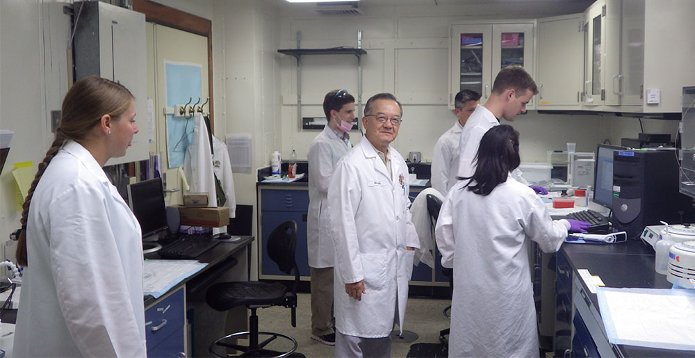 Dr. Tony Shih, center, at work in the U.S. Army Medical Research Institute of Chemical Defense lab with his research team, from left, Amber Truitt, Garrett Smith, Dr. Thaddeus Thomas, Jeffrey Koenig and Cindy Acon-Chen.