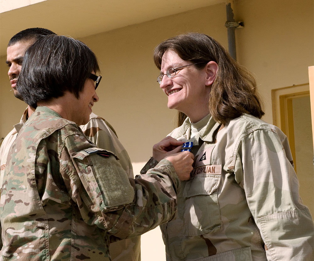 The Hon. Heidi Shyu, Assistant Secretary of the Army (Acquisition, Logistics & Technology) (ASA(ALT)) and Army Acquisition Executive, presents Robyn Litle with the Secretary of Defense Medal for the Global War On Terrorism and the ASA(ALT) Coin for Excellence for her outstanding service in Afghanistan, March 2014.