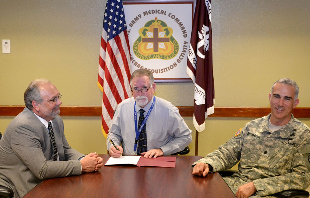 Rankin (center) meets with Brian Martin (left), director and principle assistant for contracting, Army Medical Research Acquisition Activity, and Lt. Col. Marc Bustamante, commander and principle assistant for contracting, Health Care Acquisition Activity.