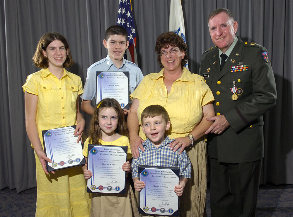 Rankin retired from active duty in 2007 at the rank of lieutenant colonel, capping more than 26 years of service. On hand to mark the occasion were his wife Lorraine, his daughters Kellie, back row, left, and Claire, and his sons Brian, back row, second from left, and Patrick.