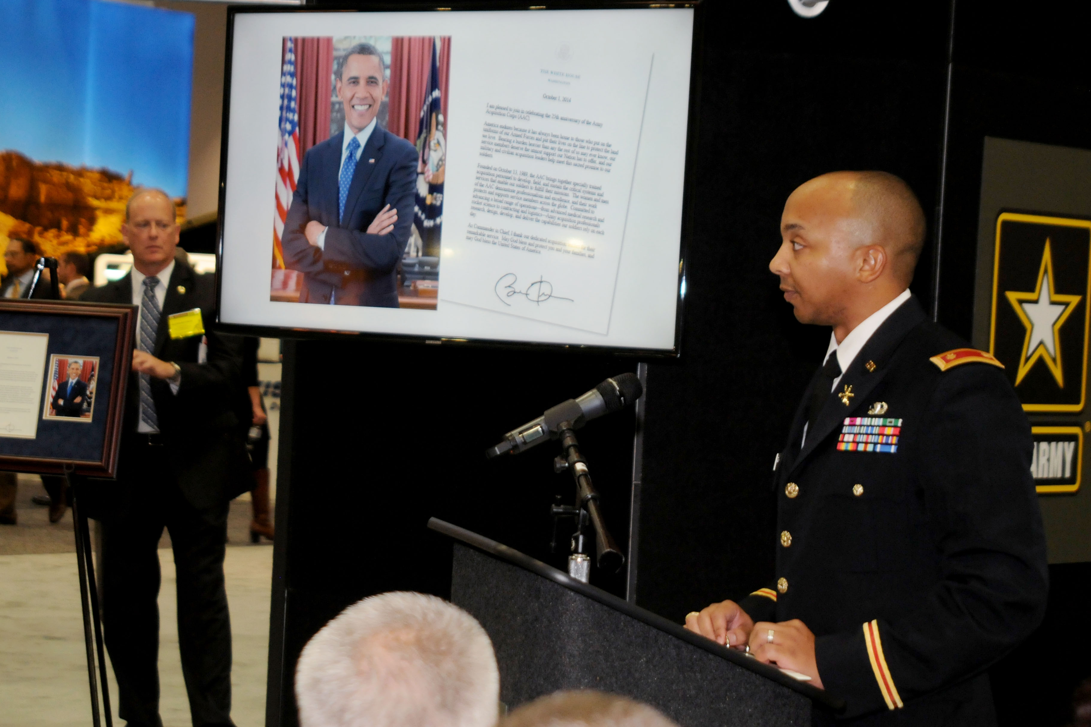 Maj. Isaac Cuthbertson reads President Obama's letter in celebration of the AAC 25th anniversary at the Oct. 13 ceremony at the AUSA annual meeting.