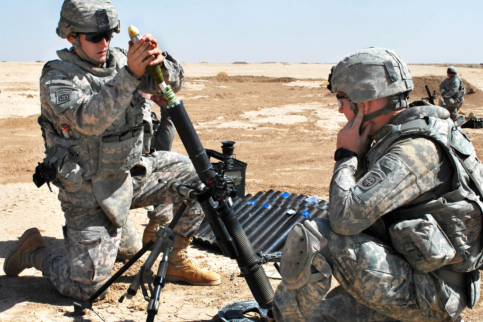 U.S. Army Pfc. Gregory Conway, left, prepares to drop a mortar into the tube during a live-fire training exercise at a range several miles north of Forward Operating Base Hammer, Iraq, Sept. 30, 2009. Conway is an indirect fire infantryman assigned to the 82nd Airborne Division's Company C, 2nd Battalion, 505th Parachute Infantry Regiment, 3rd Brigade Combat Team. (Photo by Pvt. Jared N. Gehmann)