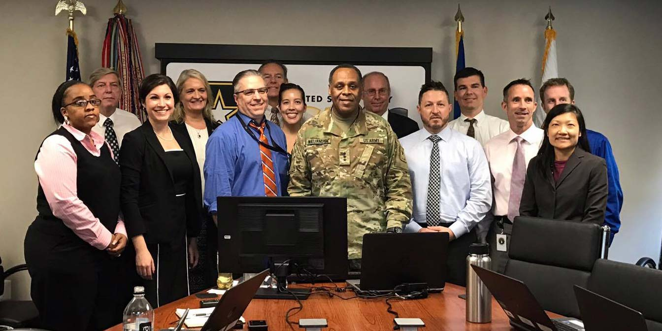 The DACM Office gathered with Lt. Gen. Williamson and Mr. Craig Spisak (center) for a photo at the conclusion of the HCSP Town Hall. The DACM office members in the photo include: Jennifer Farlow, Randy Williams, Joan Sable, Jack Kendall, Stephanie Watson, Tom Evans, Jason Pitts, Scott Greene, Brian Winters, John Kelly, Wen Lin and milSuite representative, Megan Cronhardt.