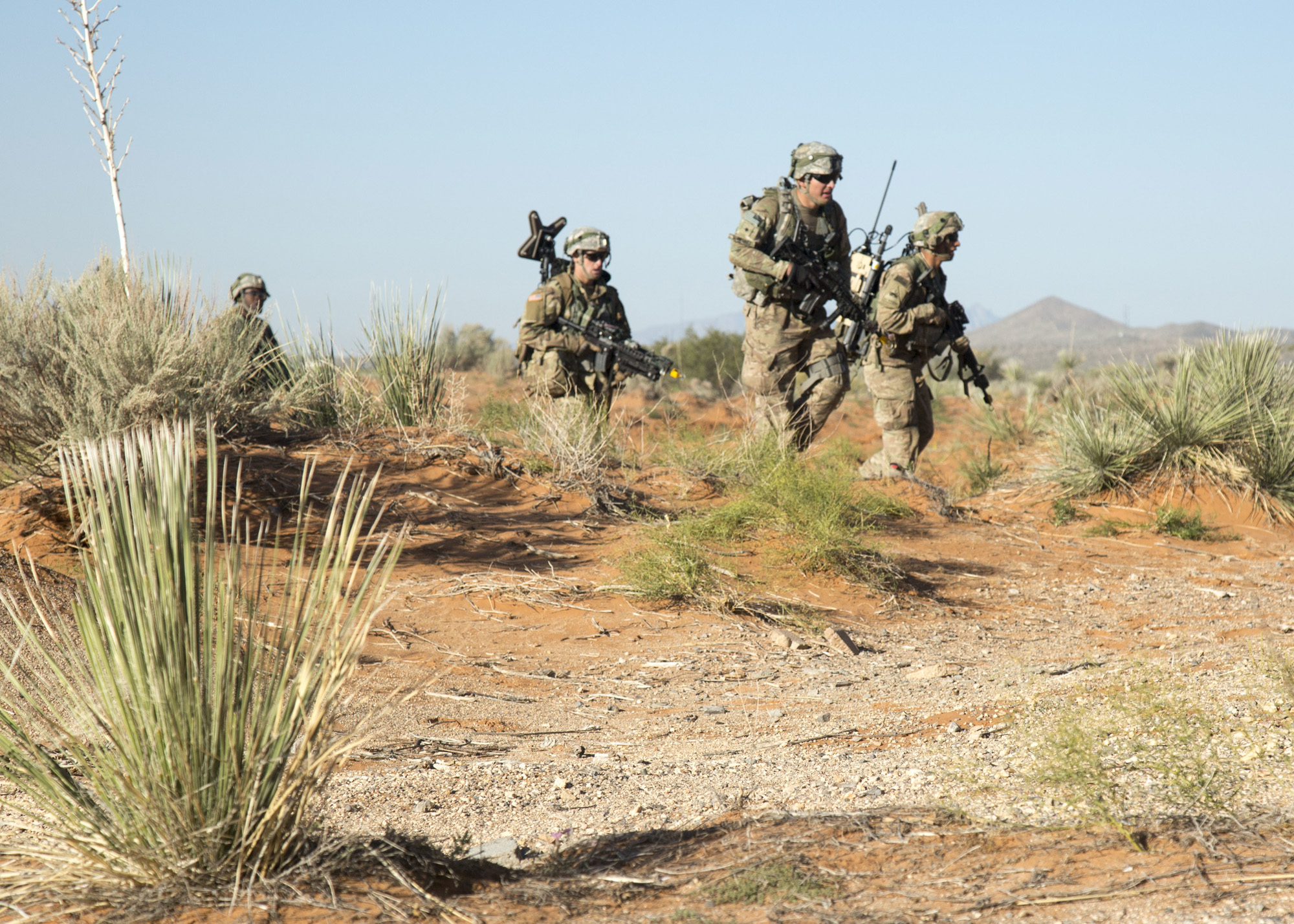 Army Infantrymen assigned to the 2nd Brigade Combat Team, 1st Armored Division assault an objective during the Army Warfighting Assessment (AWA) 17.1 at Fort Bliss, Texas, on Oct. 23, 2016. The Army Rapid Capabilities Office used the AWA, the first in what will be a series of annual events, to gather Soldier feedback on current and emerging electronic warfare and cyber technologies—part of an Armywide push to focus scarce resources where they will give Soldiers a true edge in the fight against a peer adversary. (U.S. Army photo by Spc. Tianna S. Wilson)