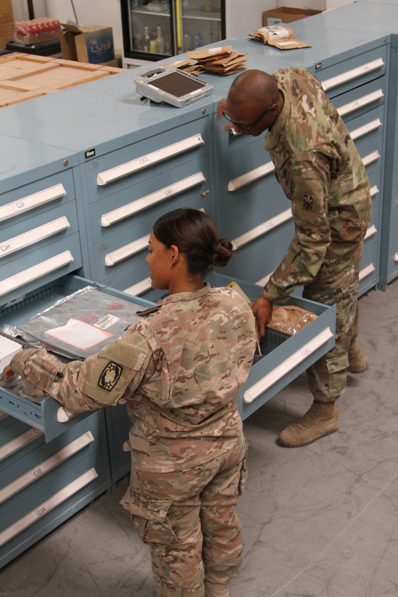 Soldiers check inventory at the supply support activity warehouse in Bahrain against data from the Global Combat Support System – Army. According to Williamson, mission dominance relies on viewing acquisition as a comprehensive process, from design and procurement to deployment, sustainment and disposal. (U.S. Army photo by Sgt. 1st Class Naurys Marte)