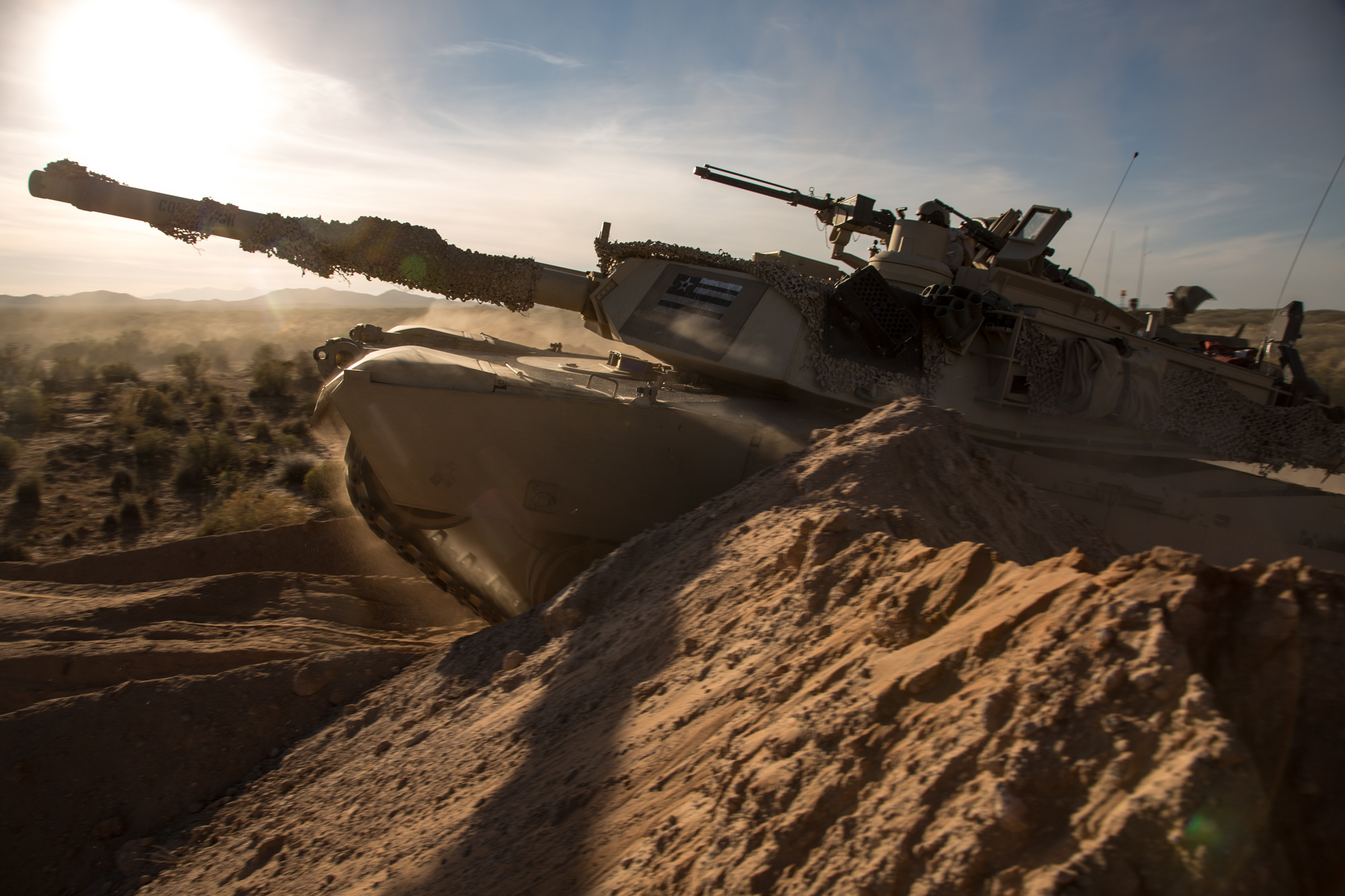 An M1A2 main battle tank assigned to 1st Battalion, 35nd Armored Regiment breaches obstacles during AWA 17.1 at Fort Bliss on Oct. 21, 2016. Active protection systems for main battle tanks are one of several critical capabilities that would be key in any conflict with a military peer like Russia, but they have atrophied in recent years as the Army has faced non-peer adversaries. The Army is focusing modernization efforts on those capability gaps. (U.S. Army photo by Pfc. Frederick Poirier, 55th Combat Camera)
