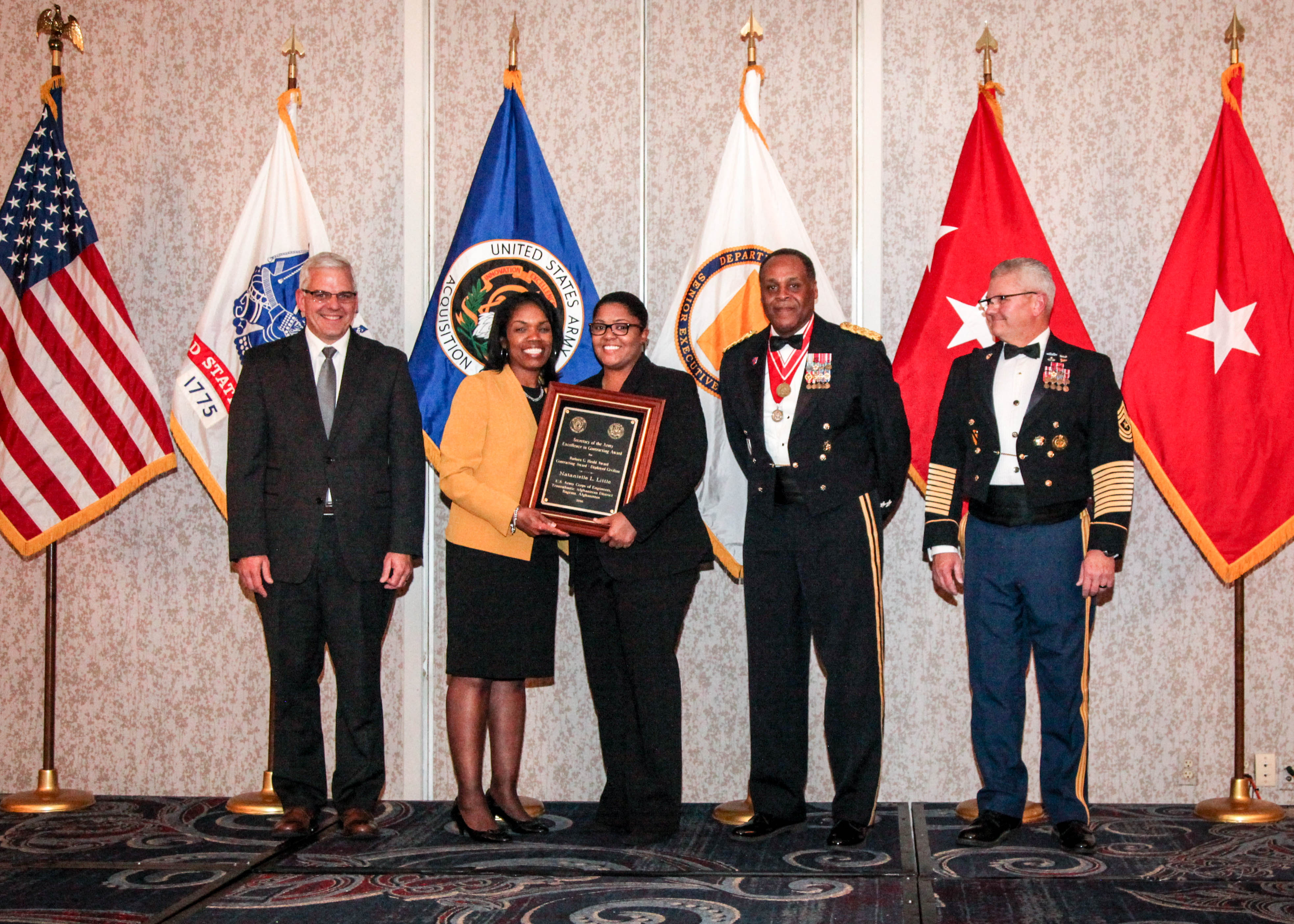 Natanielle L. Little receives the Barbara C. Heald Award during the 2016 Army Acquisition Executive's Excellence in Leadership Awards Ceremony, held Dec. 1, 2016 at Springfield, Virginia. Steffanie Easter, acting assistant secretary of the Army for acquisition, logistics and technology (ASA(ALT)) and the Army acquisition executive, presented the award to Little. Also on hand for the award presentation were, from left, Christopher Lowman, acting principal deputy to the ASA(ALT); Lt. Gen. Michael E. Williamson, principal military deputy to the ASA(ALT) and Director, Acquisition Career Management; and Sgt. Maj. Rory Malloy, sergeant major to the ASA(ALT) principal military deputy.