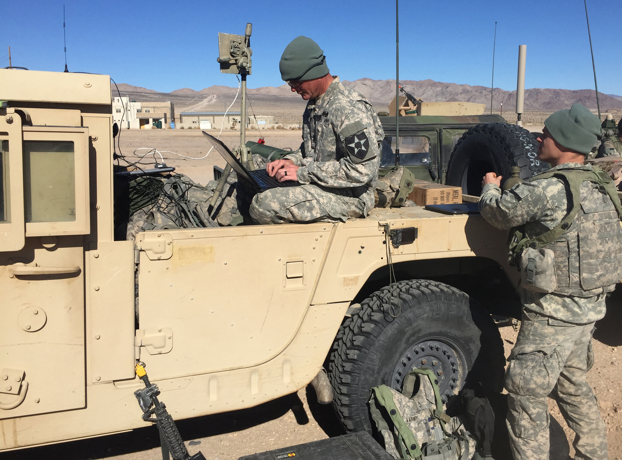 Soldiers with the 780th Military Intelligence Brigade conduct cyberspace operations during a training rotation at the National Training Center at Fort Irwin, California, in January 2016. The Fort Meade, Maryland-based 780th was one of several cyber organizations that took part in the rotation as part of a pilot program designed to help the Army develop how it will build and employ cyber in its tactical formations. (U.S. Army photo)