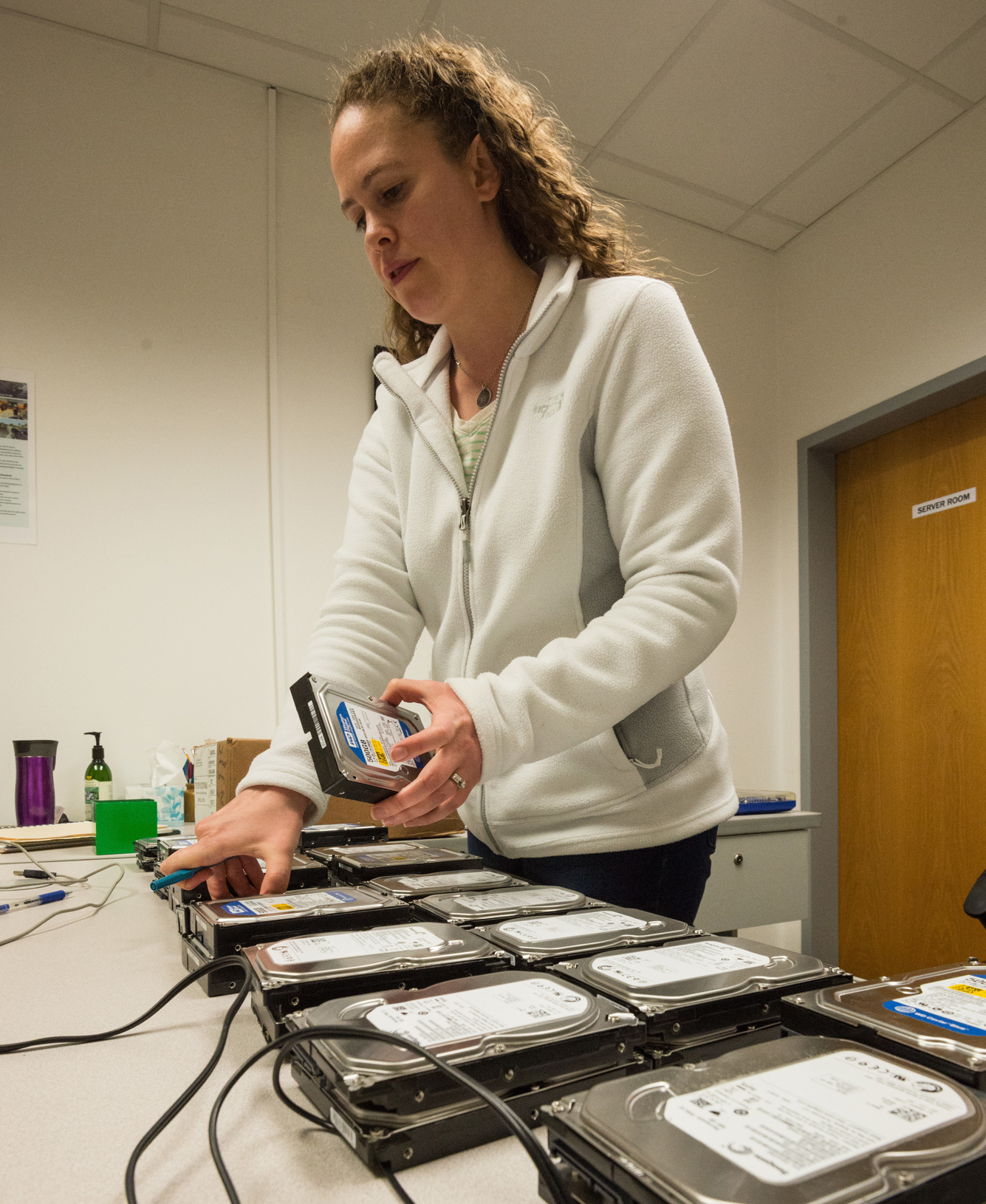 Training Support Center Benelux supply technician Stephanie Pippenger sorts hard drives in October 2016 as U.S. government employees and Belgian contractors deploy new computers in the Digital Training Facility at Chièvres Air Base, Belgium. Almost $100,000 worth of equipment was installed in the Chièvres facility. (U.S. Army photo by Visual Information Specialist Pierre-Etienne Courtejoie)