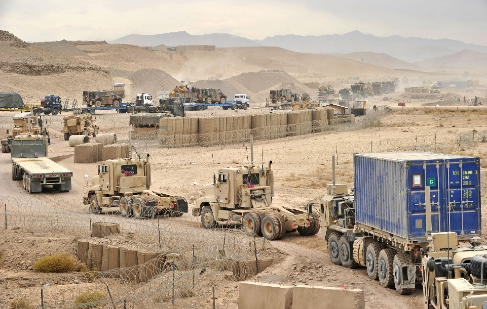 Joint Sustainment Command – Afghanistan Soldiers conduct a convoy in southern Afghanistan to relocate equipment between Tarin Kowt and Kandahar. CERDEC is exploring artificial intelligence technologies that could perform logistics analysis to determine when, where and how to conduct maneuvers like this to resupply critical mission assets. (Photo by Lt. Stephen P. Haggerty, 1225th Combat Sustainment Support Battalion, Army National Guard Element, Joint Force Headquarters Michigan)
