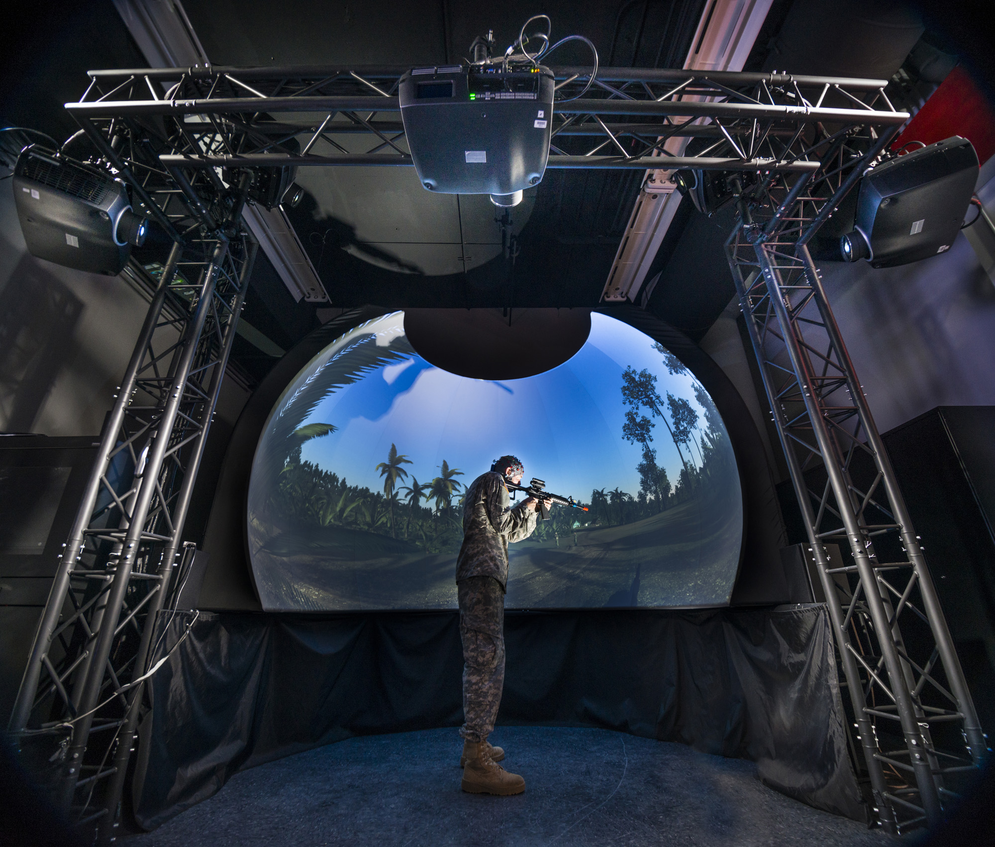 This virtual reality dome at the Natick Soldier Research, Development and Engineering Center (NSRDEC) allows researchers to assess environmental and equipment impacts on Soldier cognition, including decision-making, spatial memory and finding their way. The research is part of the broader mission of the Center for Applied Brain and Cognitive Sciences, created jointly by NSRDEC and the Tufts University School of Engineering, which will examine Soldier interactions with autonomous robotic platforms to augment and optimize human cognition, mood and physical capabilities. (Photo by David Kamm, U.S. Army Research, Development and Engineering Command)
