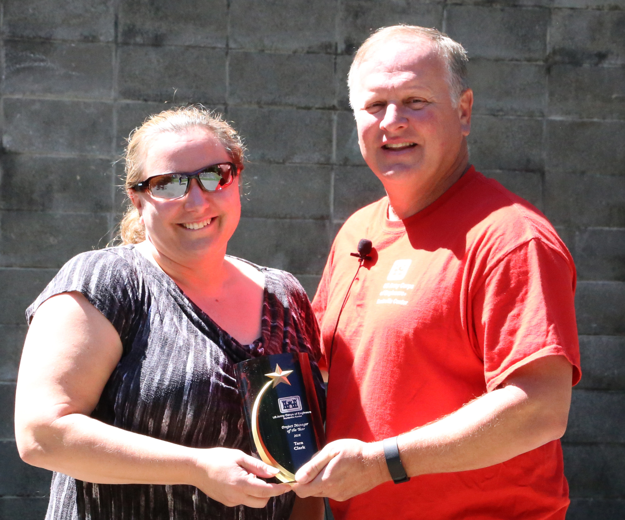 Tara Clark, project manager for the Ballistic Missile Defense Branch, receives the Project Manager of the Year Award from Col. Robert J. Ruch, then commander at the Huntsville Center, at an award ceremony in June 2016. (Photo by Rusty Torbett, Visual Information Specialist, U.S. Army Corps of Engineers.)