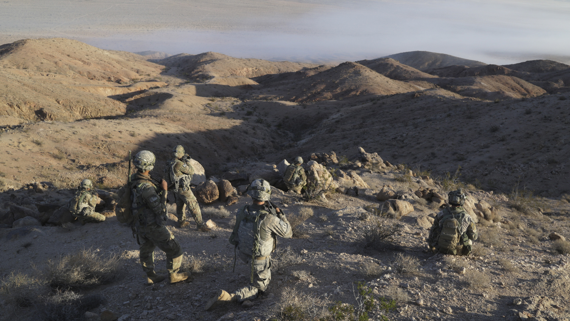 Soldiers assigned to 1st Brigade Combat Team, 1st Armored Division scan for potential enemies during Decisive Action Rotation 17-02 at the National Training Center on Fort Irwin, California in November 2016. The Army's Talent Management Task Force is piloting several initiatives to move from an industrial-age system where Soldiers were viewed as interchangeable parts to a modern 21st-century system managing individual knowledge, skills and behaviors shaped over a lifetime. (Photo by Spc. Michael Crews, National Training Center Operations Group)