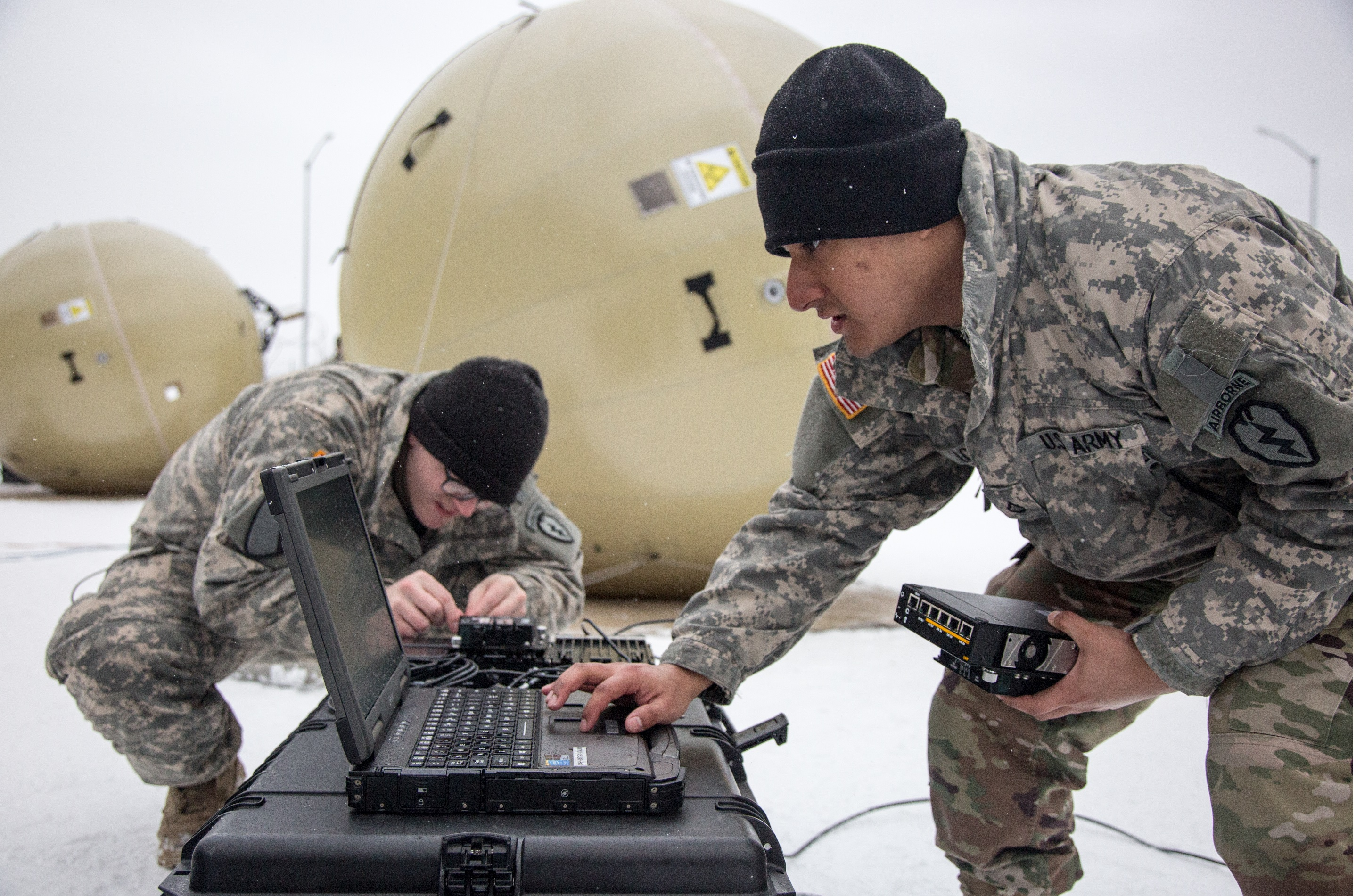 Soldiers from the 4th Infantry BCT (Airborne), 4/25, prepare for the March WIN-T T2C2 operational test at Joint Base Elmendorf-Richardson. The satellite communications system connects units at the edge of the battlefield to the Army's tactical network. (Photo by Staff Sgt. Pedro Garcia Bibian, 55th Signal Company (Combat Camera))
