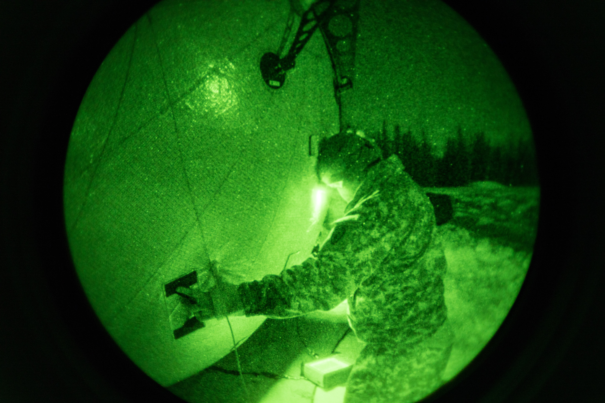 4th Infantry BCT (Airborne) Soldiers work with the T2C2 SATCOM terminal at night at Joint Base Elmendorf-Richardson, in March. The inflatable terminal offers connectivity in remote locations at half the weight of current systems. (Photo by Staff Sgt. Pedro Garcia Bibian, 55th Signal Company (Combat Camera))