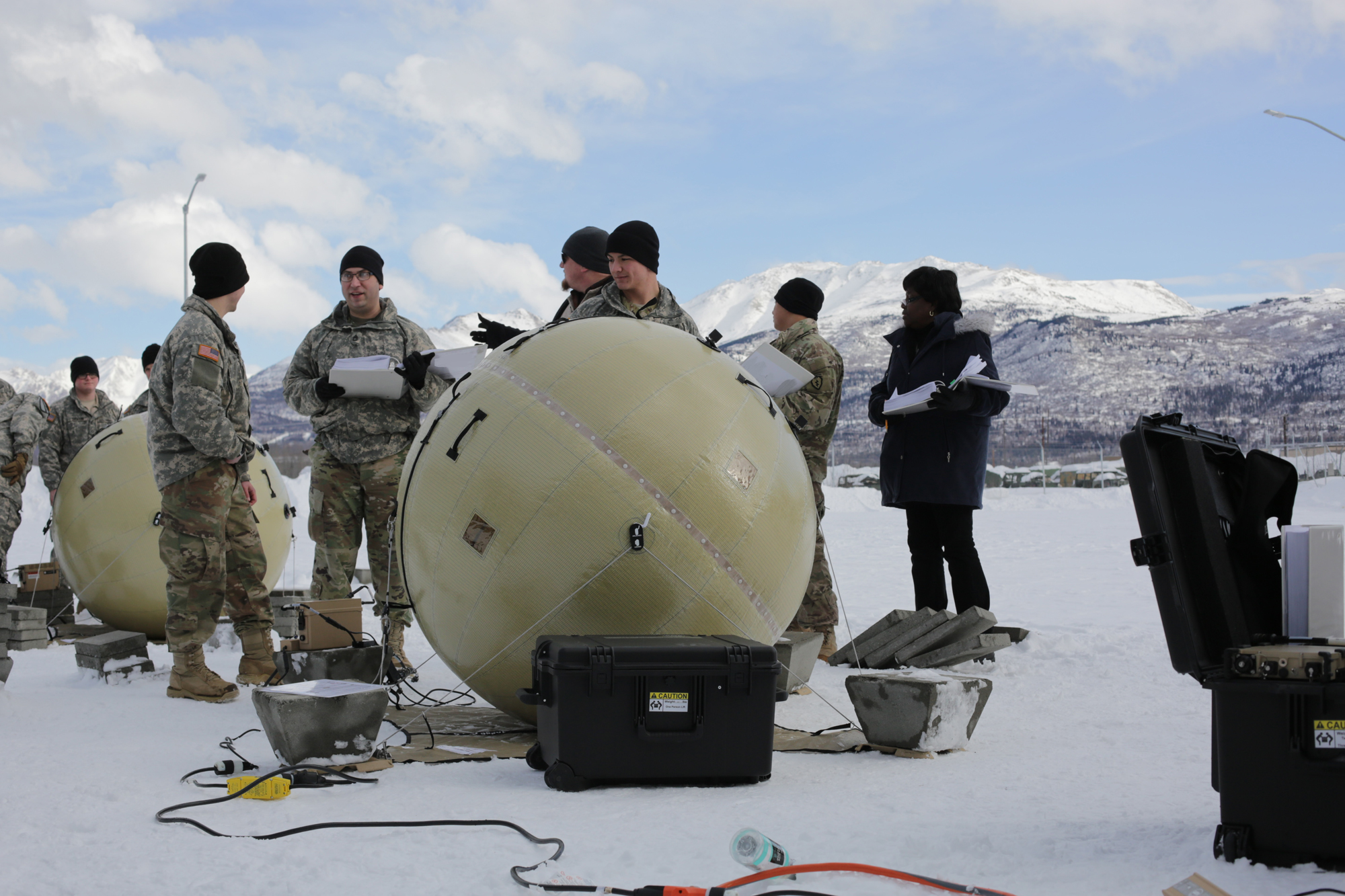 Soldiers use the technical manual to troubleshoot procedures to correct faults inflicted on their system as part of the March test at Joint Base Elmendorf-Richardson, Alaska. Early feedback indicates that non-specialist users can easily set up the terminals, use the system to access the tactical network, and troubleshoot issues using the manual. (Photo by Staff Sgt. Pedro Garcia Bibian, 55th Signal Company (Combat Camera))