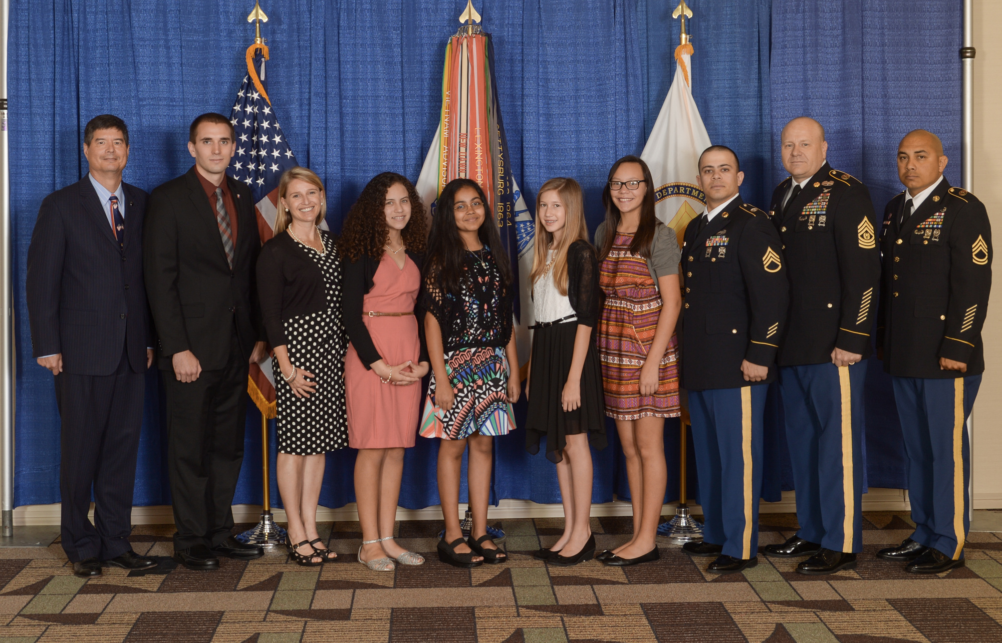 From left to right, Jyuji Hewitt, Frank Bohn, Ingrid Rapatz-Roettger, Janat Khan, Luz Figueroa-Rodriguez, Janeliz Guzman Acevedo, Bria Roettger, Sgt. 1st Class Jose Roldan, Command Sgt. Maj. James Snyder and Sgt. 1st Class Ernest Robledo. Khan, Figueroa-Rodriguez, Acevedo and Roettger, sixth-graders from Puerto Rico, make up Team Las Chicas and won the eCybermission national competition in 2016 for their work on an interactive website that serves as a warning system for people in their community who suffer with respiratory issues from the effects of Saharan dust. (U.S. Army photo)