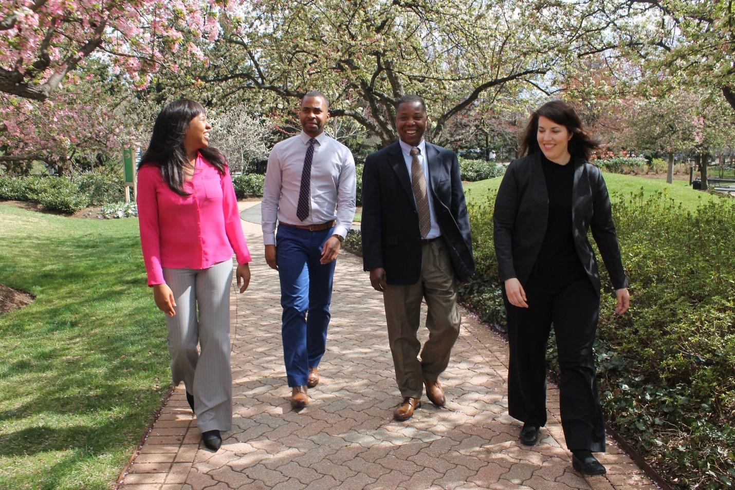 April Miller, Nick Curry, Freeman Nlandu and Jennifer Griffin, from left, enjoy the cherry blossoms outside the Taylor Building in Crystal City, Virginia. The Rotational Assignment Program demonstrates the Army's commitment to participating employees while also expanding the employees' knowledge of DOD's security cooperation mission.