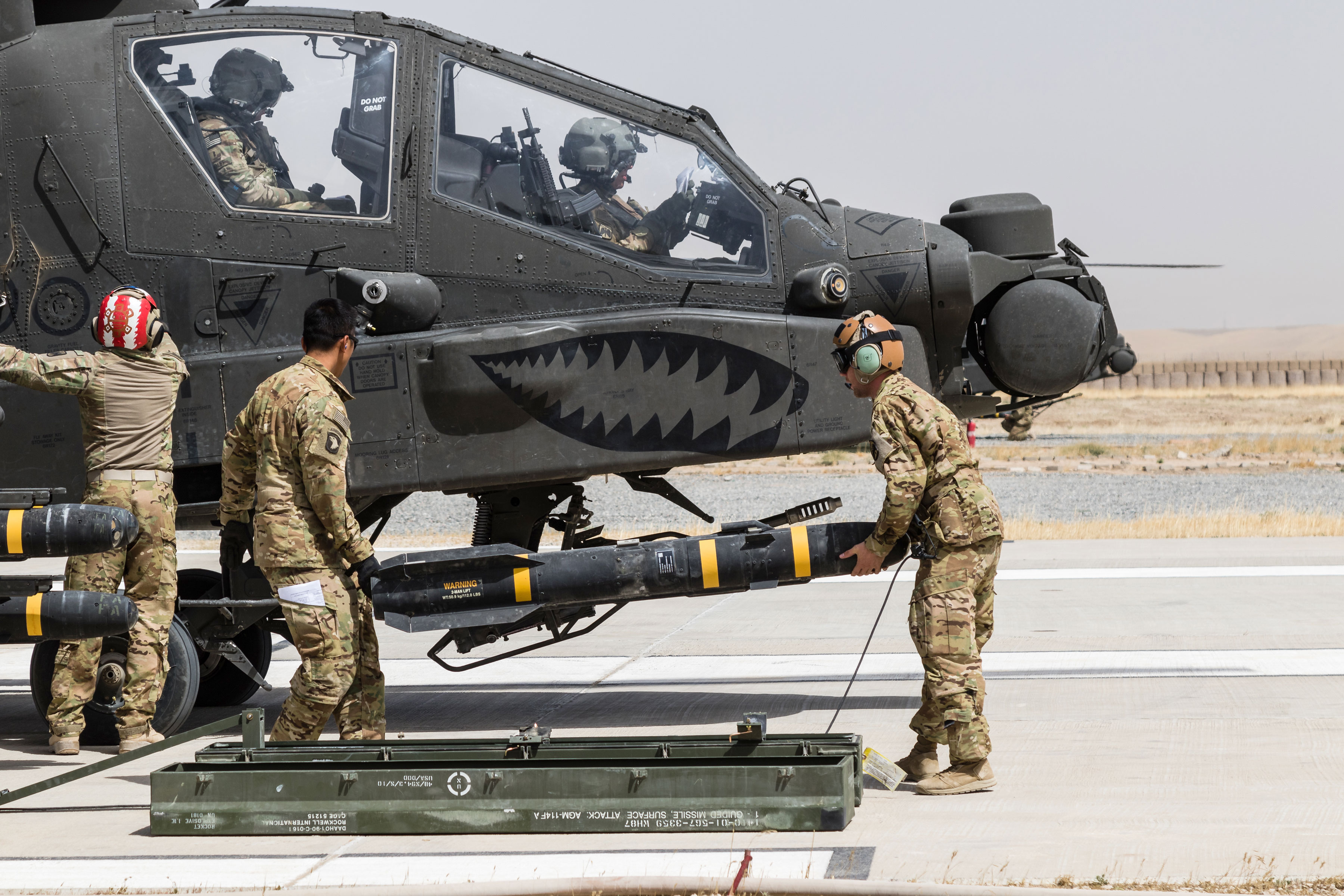 Soldiers assigned to Task Force Griffin, 16th Combat Aviation Brigade (CAB), 7th Infantry Division load an AGM-114 HELLFIRE missile on an AH-64E Apache helicopter in Kunduz, Afghanistan, in May. This support for U.S. Forces Afghanistan is possible, in turn, because of long-standing, ongoing relationships between government and the private sector in research and development. Cultivating and maintaining such ties helps Army acquisition ensure that its development and acquisition strategies will produce the best, most up-to-date and effective equipment. (U.S. Army photo by Capt. Brian Harris, 16th CAB)