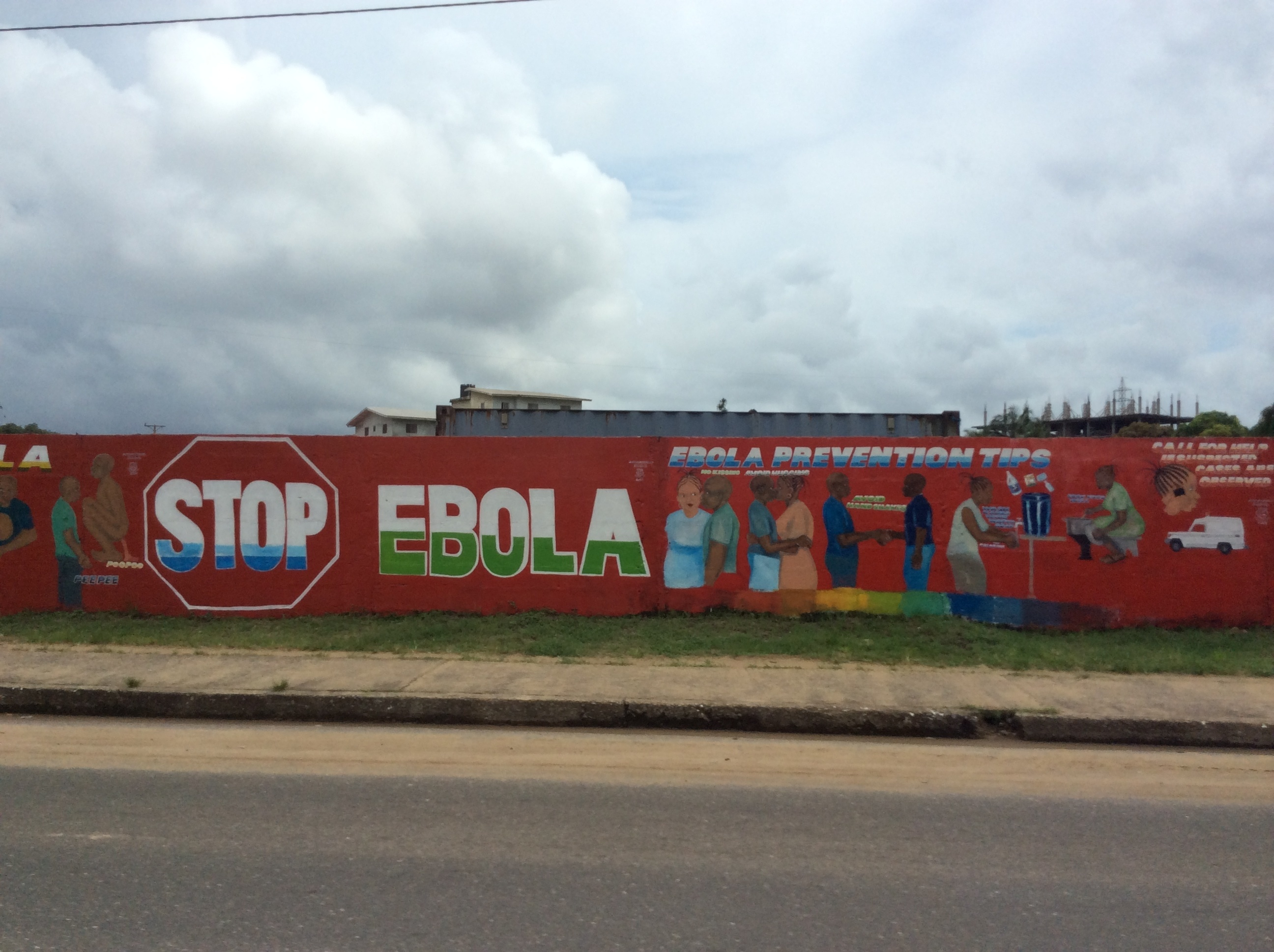 A mural at the outskirts of Monrovia, Liberia, during the Ebola outbreak that affected thousands of Liberians in 2014 and 2015. Aylward was put in charge of the international response to the outbreak after earlier WHO efforts—hobbled by years of budget and staffing cuts—were criticized as tentative and inadequate. (U.S. Army photo by U.S. Army Corps of Engineers, Savannah District)