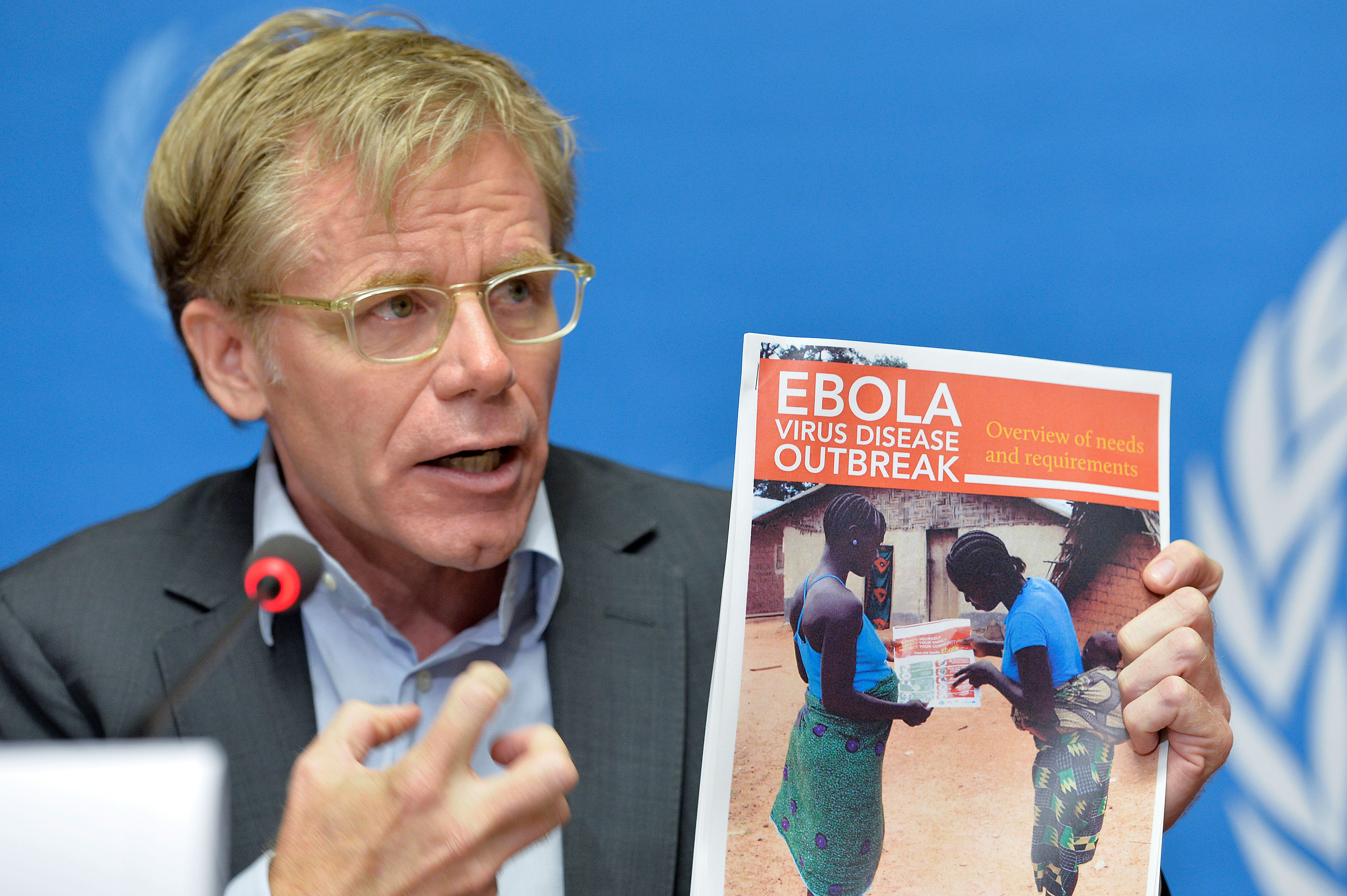 """Dr. Bruce Aylward delivers his plan for an international response to the West Africa Ebola outbreak at a September 2014 press conference at the World Health Organization at Geneva. The first step in dealing with an emergency, says Aylward, """"is break down the unknown, because we actually know a lot more than we often recognize that we know."""" (U.N. photo by Jean-Marc Ferré)"""