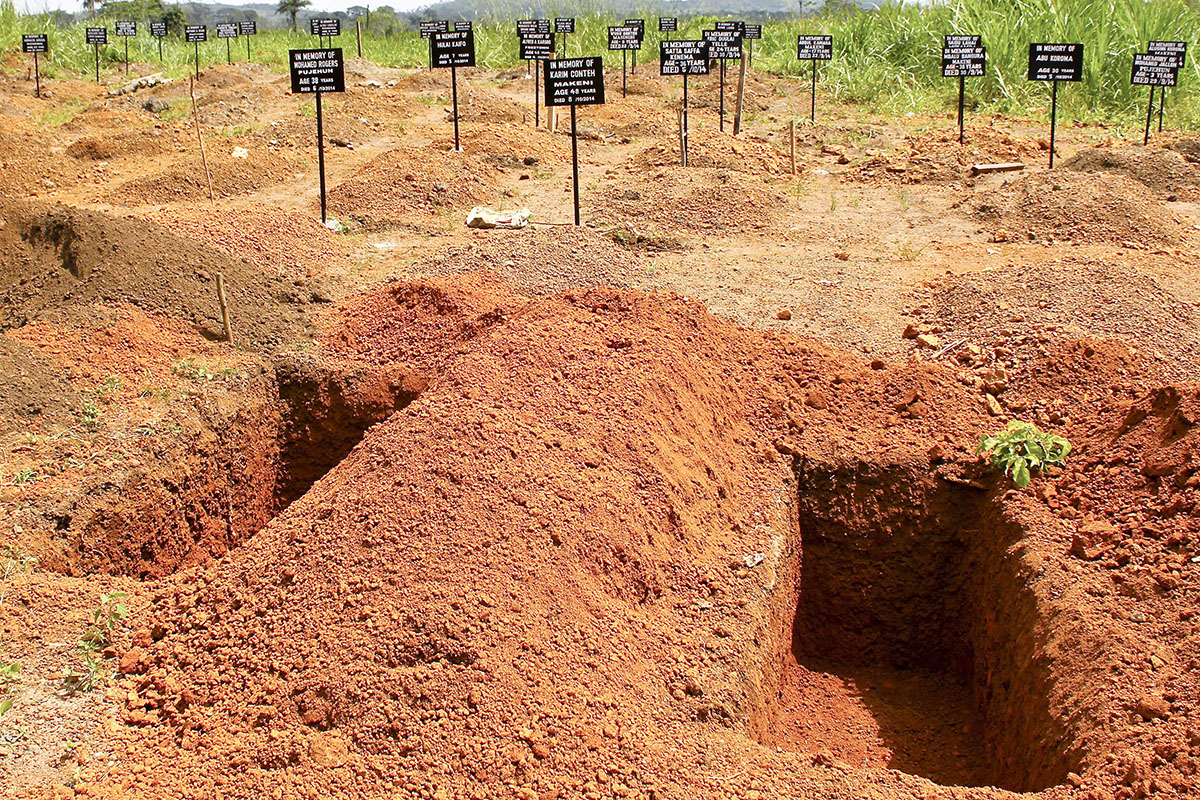 A safe burial site for Ebola victims in Freetown, Sierra Leone. To marshal a diverse coalition of international partners to action, Aylward laid out a straightforward goal to slow the outbreak: get 70 percent of dead bodies buried, and 70 percent of infected people into medical isolation, within 60 days. Prompt, safe burial is important because the Ebola virus can be transmitted to family members preparing a victim's body for burial. (U.N. photo by Ari Gaitanis)