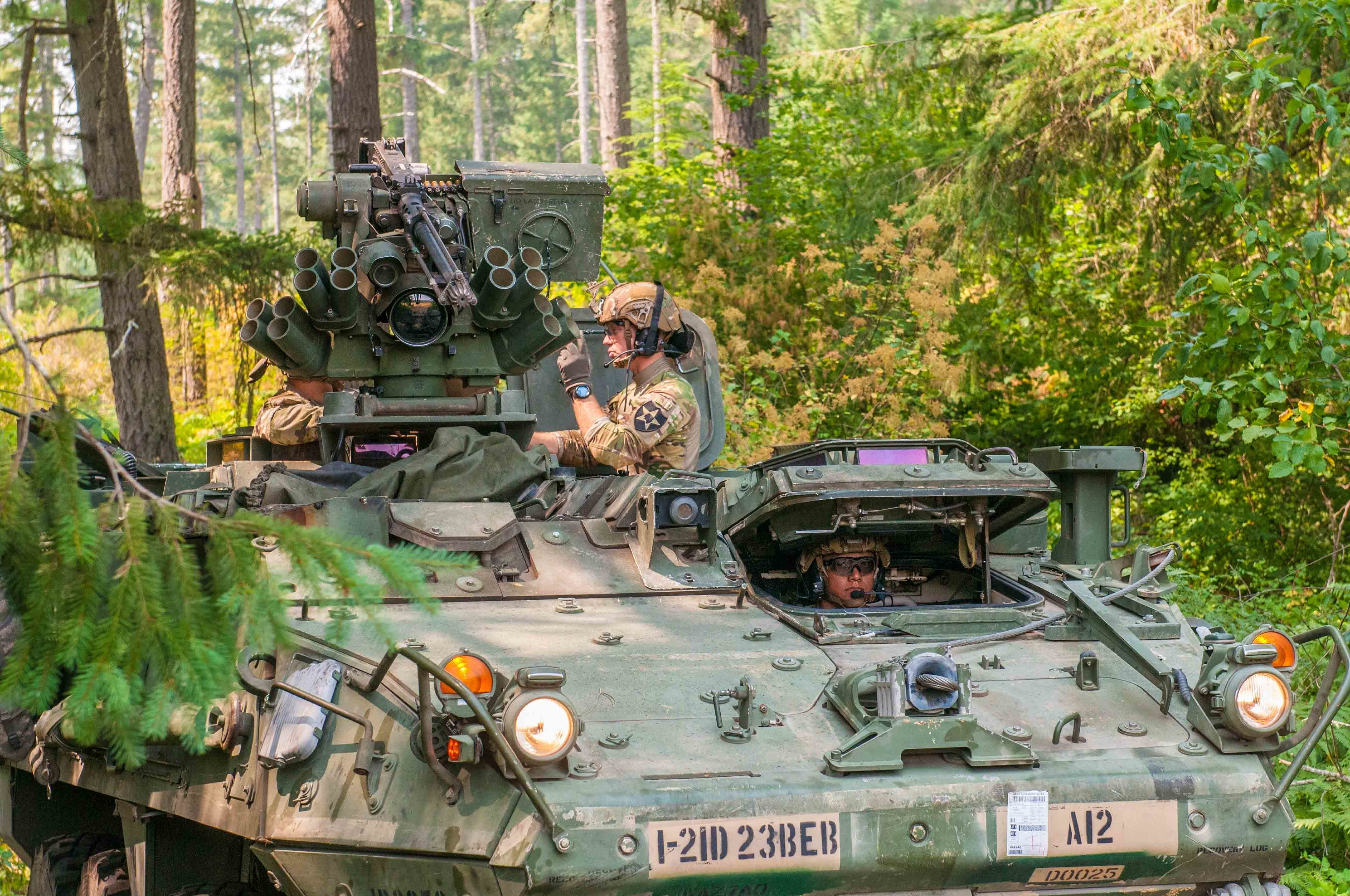 Soldiers with 23rd Brigade Engineer Battalion, 1-2 Stryker Brigade Combat team, 7th Infantry Division prepare a M1126 Stryker for a mission on Joint Base Lewis-McChord, August 8, 2017 during an operational test of the Integrated Head Protection System (IHPS) and Tactical Communication and Protective System Lite (TCAPS-L) hearing protection. Soldiers put the IHPS and TCAPS-L to the test while conducting training and gave feedback to data collectors about the equipment's performance. (U.S. Army photo by Sgt. Youtoy Martin, 5th Mobile Public Affairs Detachment)