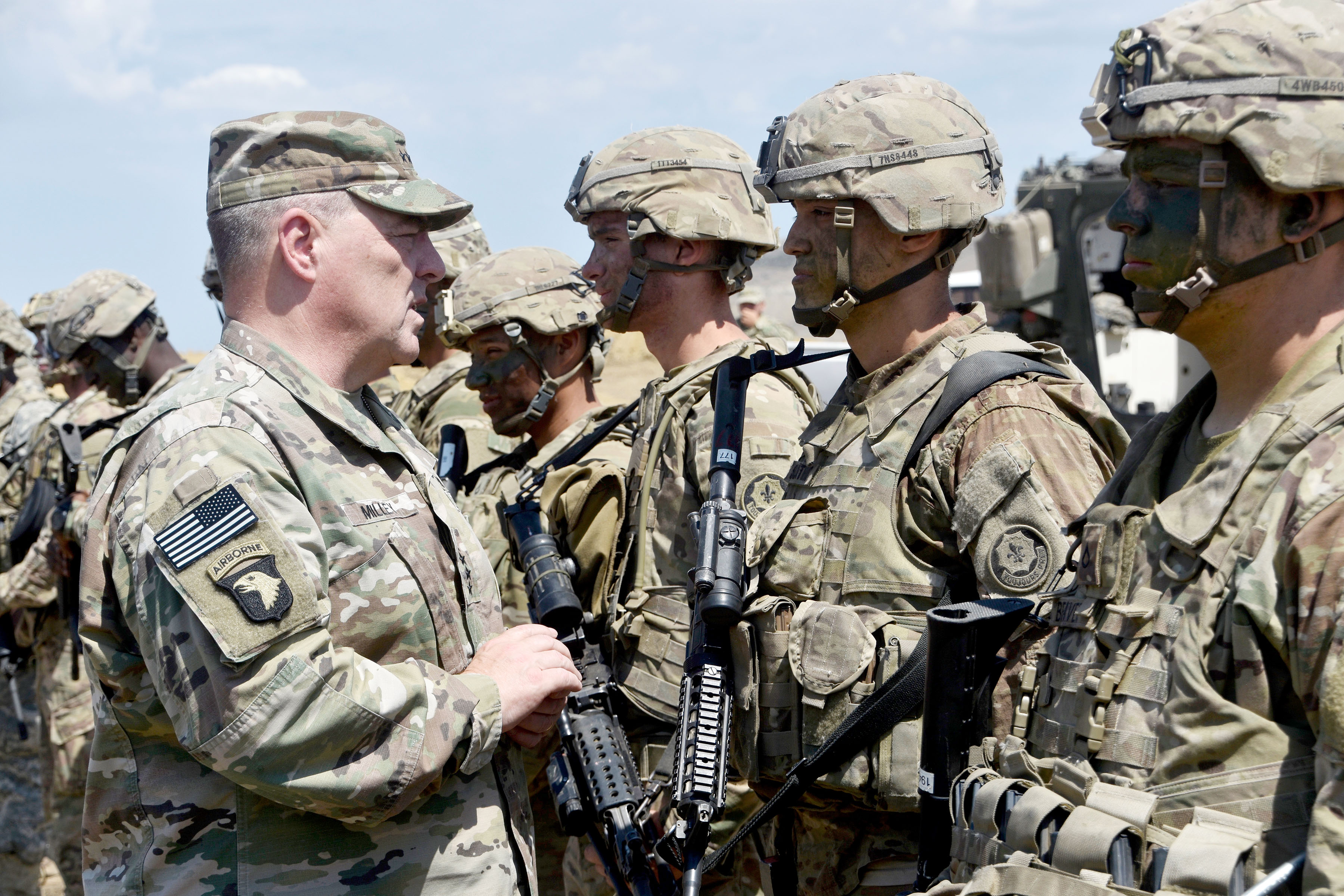 Gen. Mark A. Milley, U.S. Army chief of staff, hands out coins Aug. 10 to Soldiers assigned to 2nd Cavalry Regiment during Exercise Noble Partner 2017 in Vaziani, Georgia. Noble Partner is designed to prepare the Georgian military for its contribution to the NATO Response Force. Milley's emphasis on readiness as the Army's No. 1 priority has sparked far-reaching conversation on what readiness is and how it can be achieved. (Photo by Capt. Judith Marlowe, 2nd Cavalry Regiment)