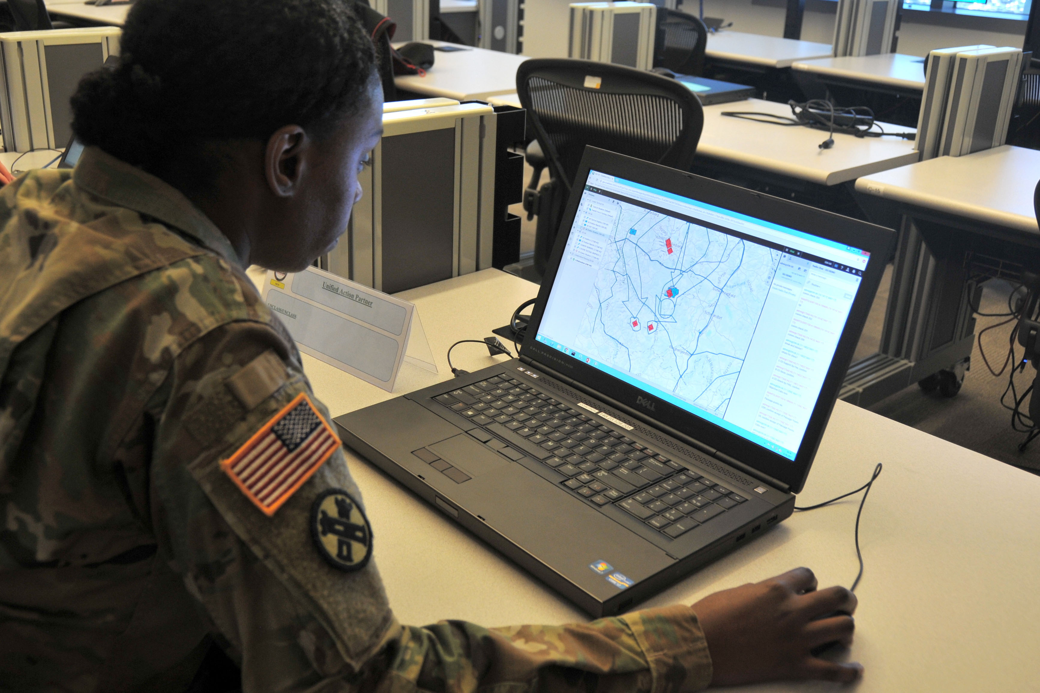 Maj. Summer Favors demonstrates the Command Post Computing Environment prototype at Aberdeen Proving Ground, Maryland, on May 16, 2017. (Photo Credit: Dan Lafontaine (PEO C3T Public Affairs))