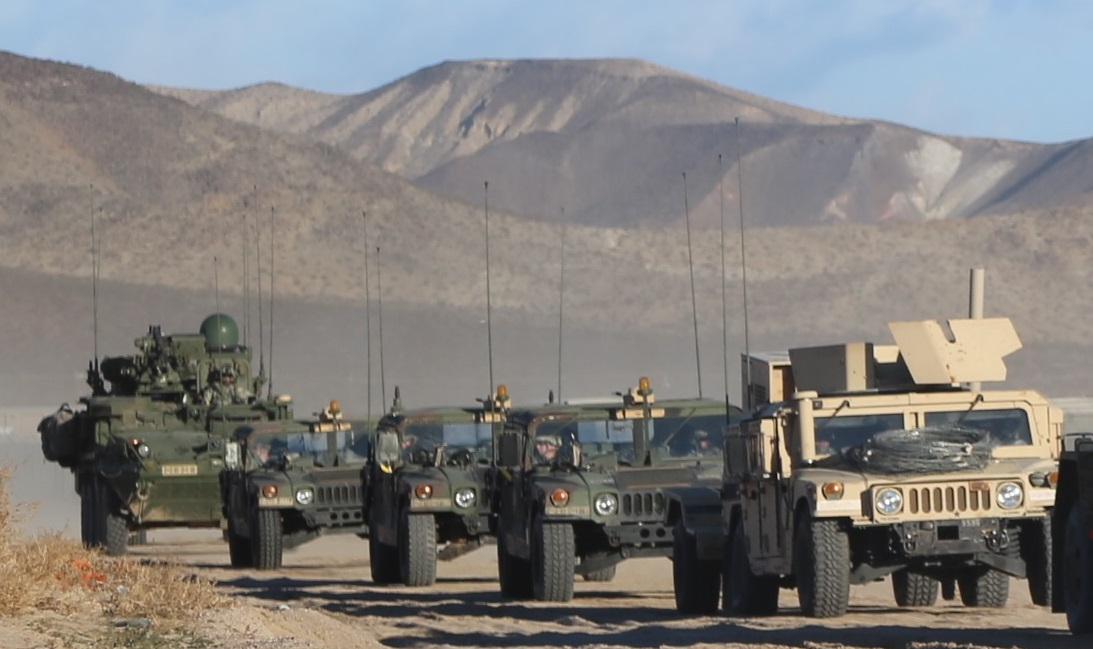 Vehicles equipped with mobile WIN-T, including the Stryker at the end of this convoy at the National Training Center (NTC), Fort Irwin, California, enable mobile mission command, advanced communication and a real-time common operating picture from anywhere on the battlefield. PM Tactical Network will continue to improve WIN-T, as well as the rest of the Army's tactical network, across all echelons and domains. (U.S. Army photo courtesy of the NTC Operations Group)