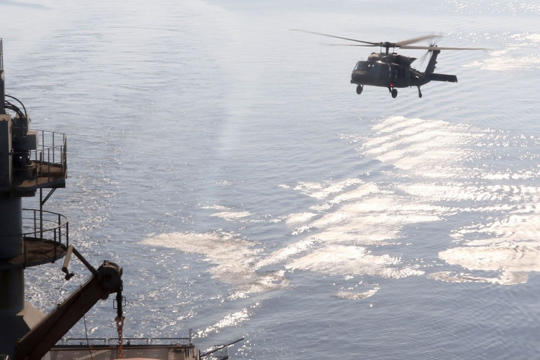 Soldiers assigned to Bravo and Headquarters Company, 1st Brigade, 147th Air Assault Helicopter Battalion, and 2nd Brigade, 149th Air General Support Aviation Battalion, conduct a deck landing qualification with a UH-60 Black Hawk on a U.S. Navy ship on Aug. 9, 2017, in the Arabian Gulf. The Black Hawk is one of the military systems developed in the 1970s known as the Big Six. It remains a core element of the Army's military power today. (U.S. Army photo by Staff Sgt. Jeremy Miller, 35th Infantry Division)