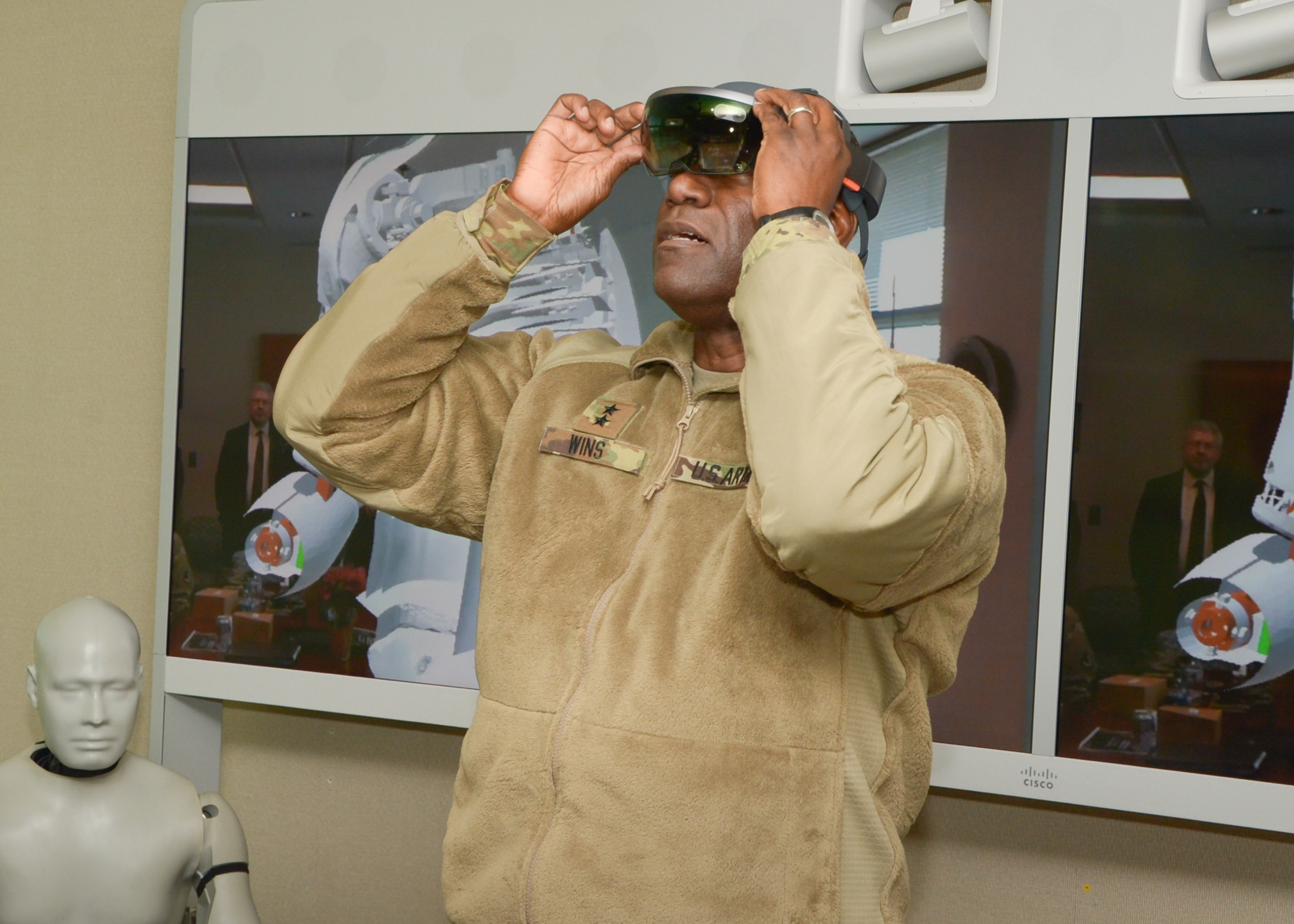 RDECOM Commander Maj. Gen. Cedric T. Wins dons advanced holographic glasses -- the Hololens from Microsoft. Researchers use the glasses to virtually explore simulations and gain new understanding of how blast injuries affect Soldiers. (Photo credit: Conrad Johnson)