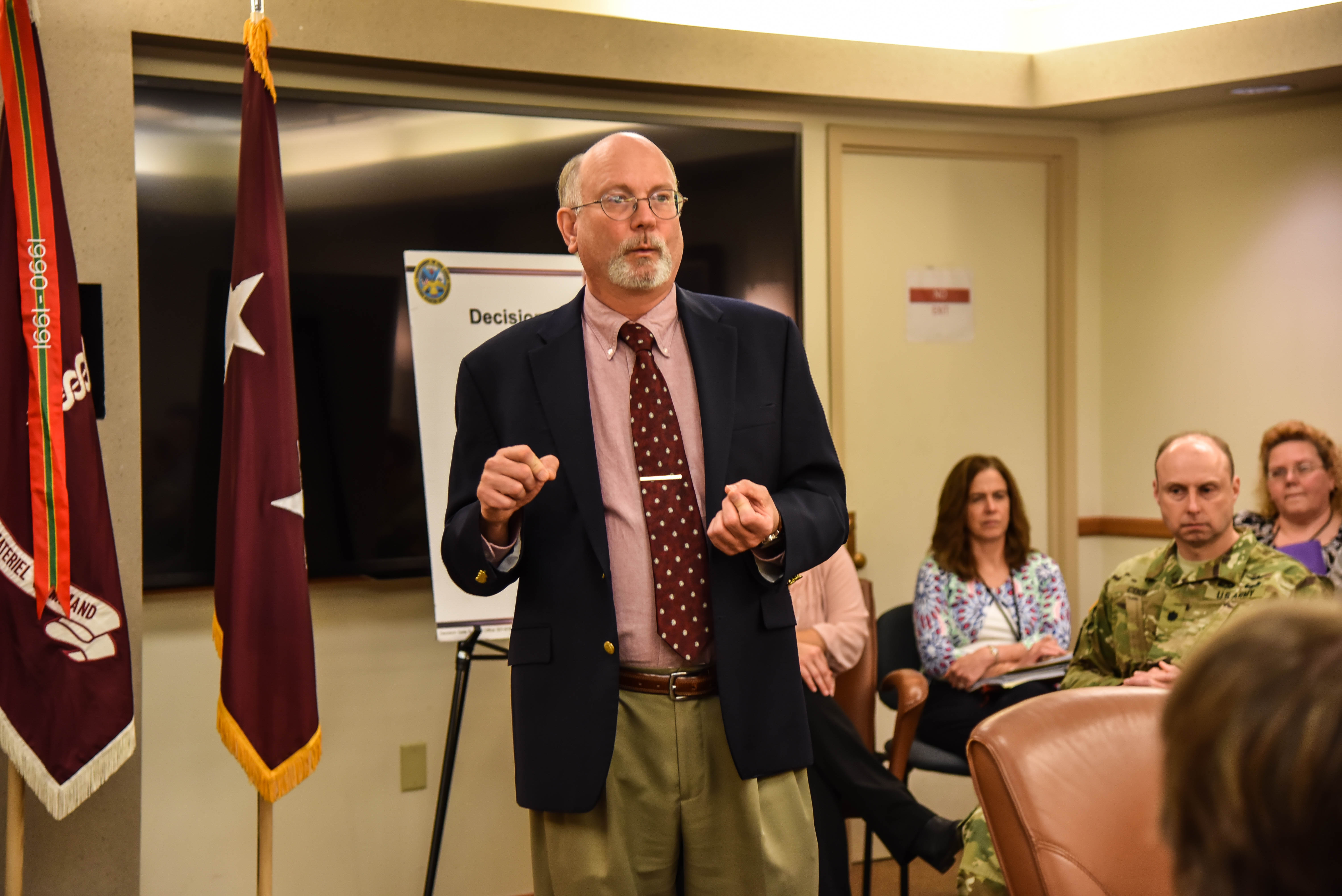 Dr. Kenneth Bertram addresses the workforce during the 2016 Decision Gate Awards ceremony USAMRMC headquarters at Fort Detrick. (U.S. Army photo by Crystal Maynard, USAMRMC)